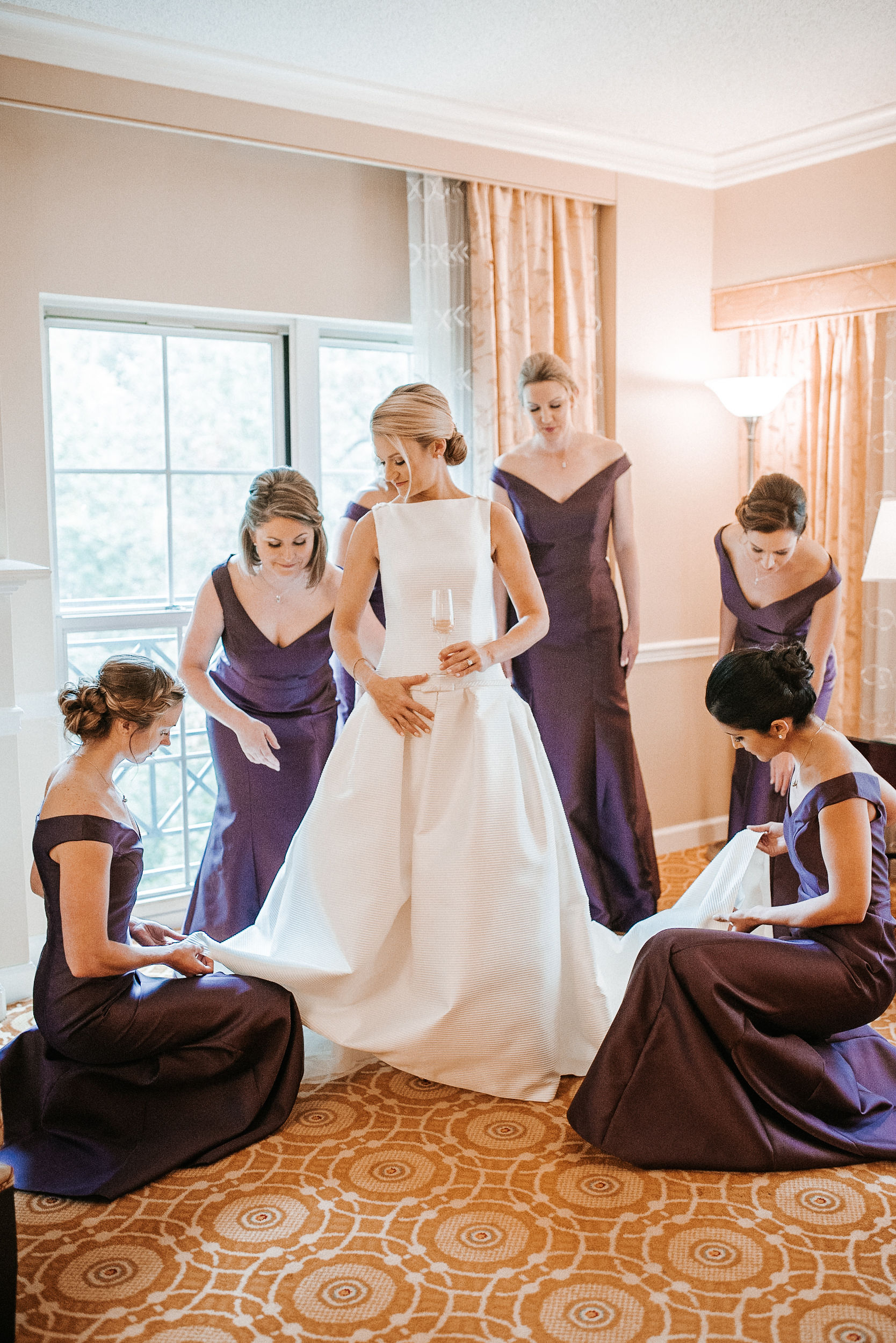 bridesmaids helping bride get ready at St. Mark Orthodox Church