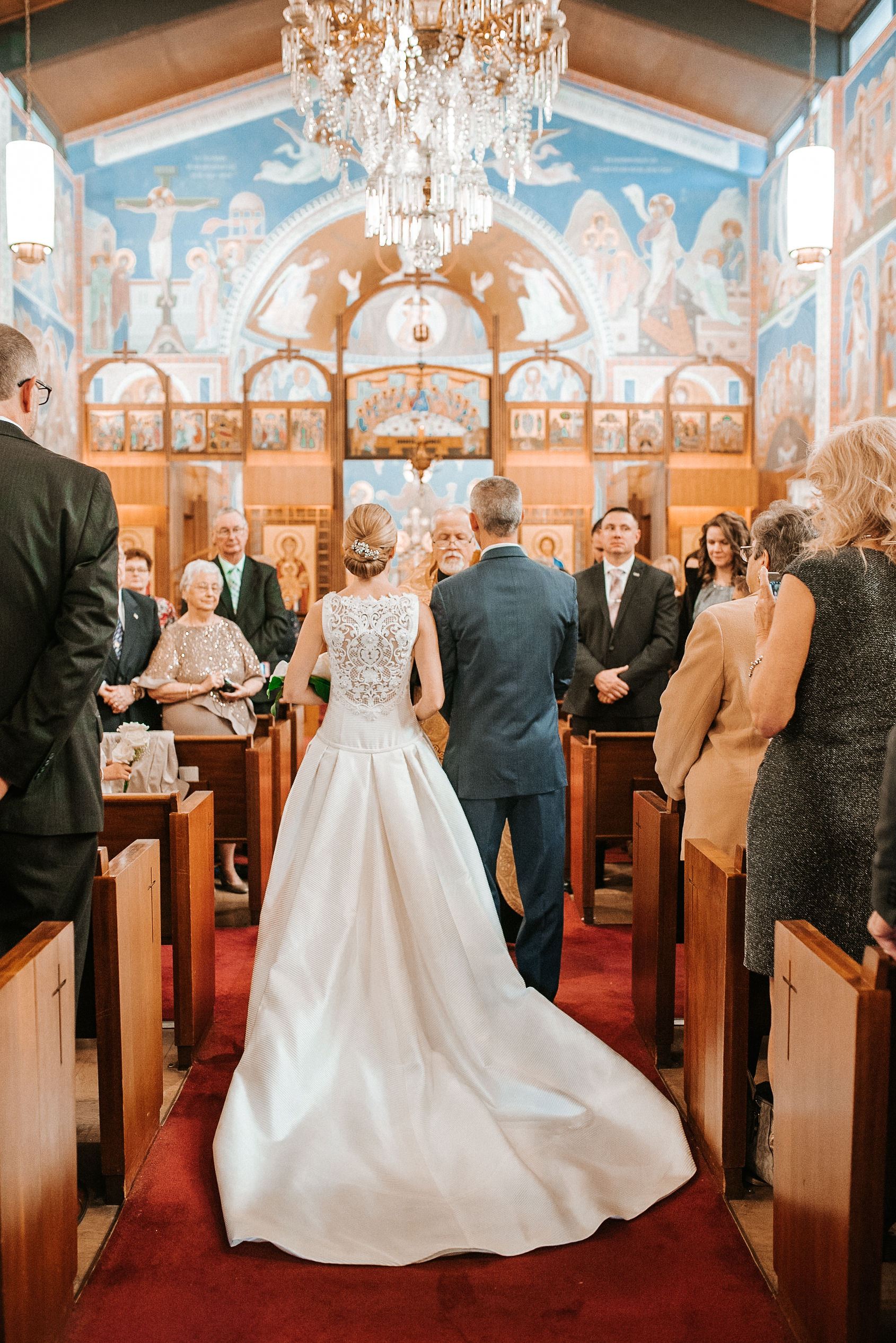 bride and groom at the alter at St. Mark Orthodox Church