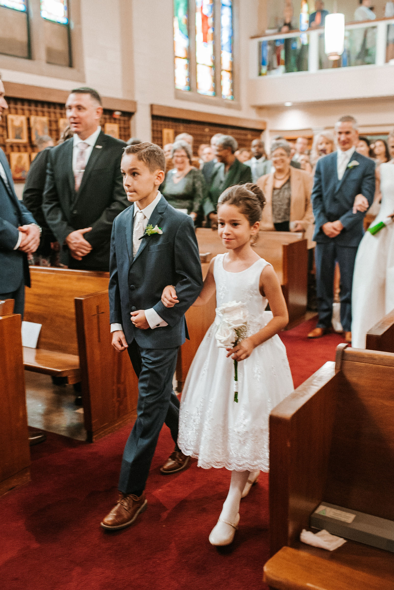 ring bearer and flower girl walking up the aisle at St. Mark Orthodox Church