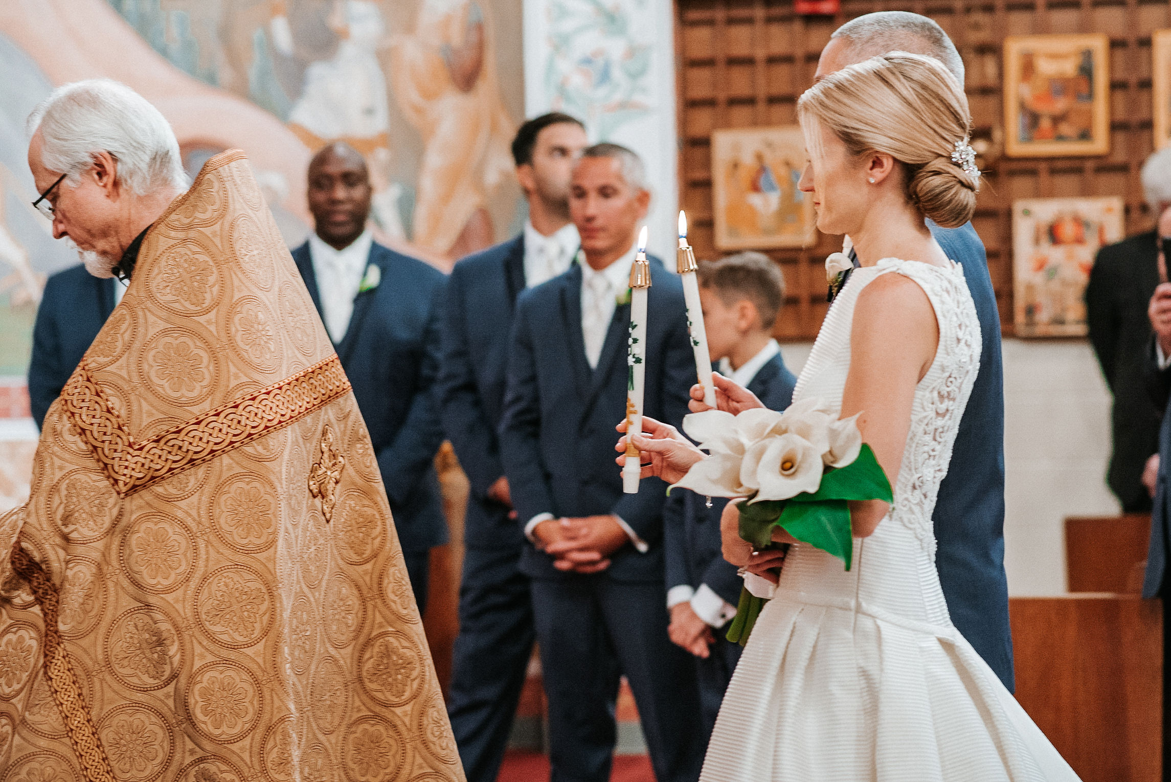 bride and groom practicing traditions at wedding ceremony at St. Mark Orthodox Church