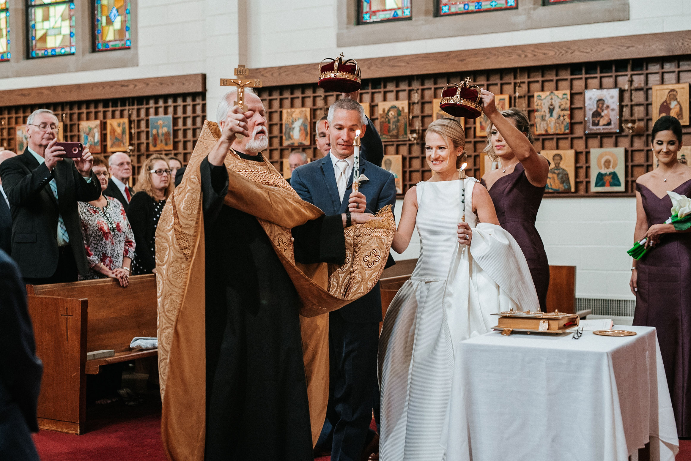 bride and groom practicing wedding traditions at St. Mark Orthodox Church