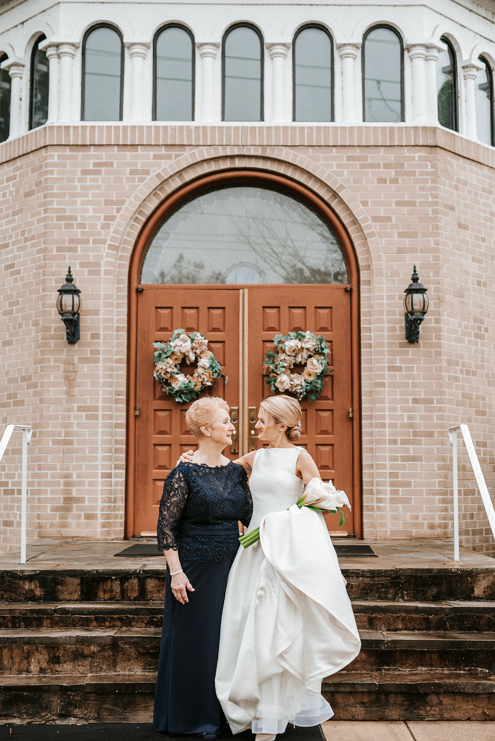 bride and mother of the bride posing at St. Mark Orthodox Church