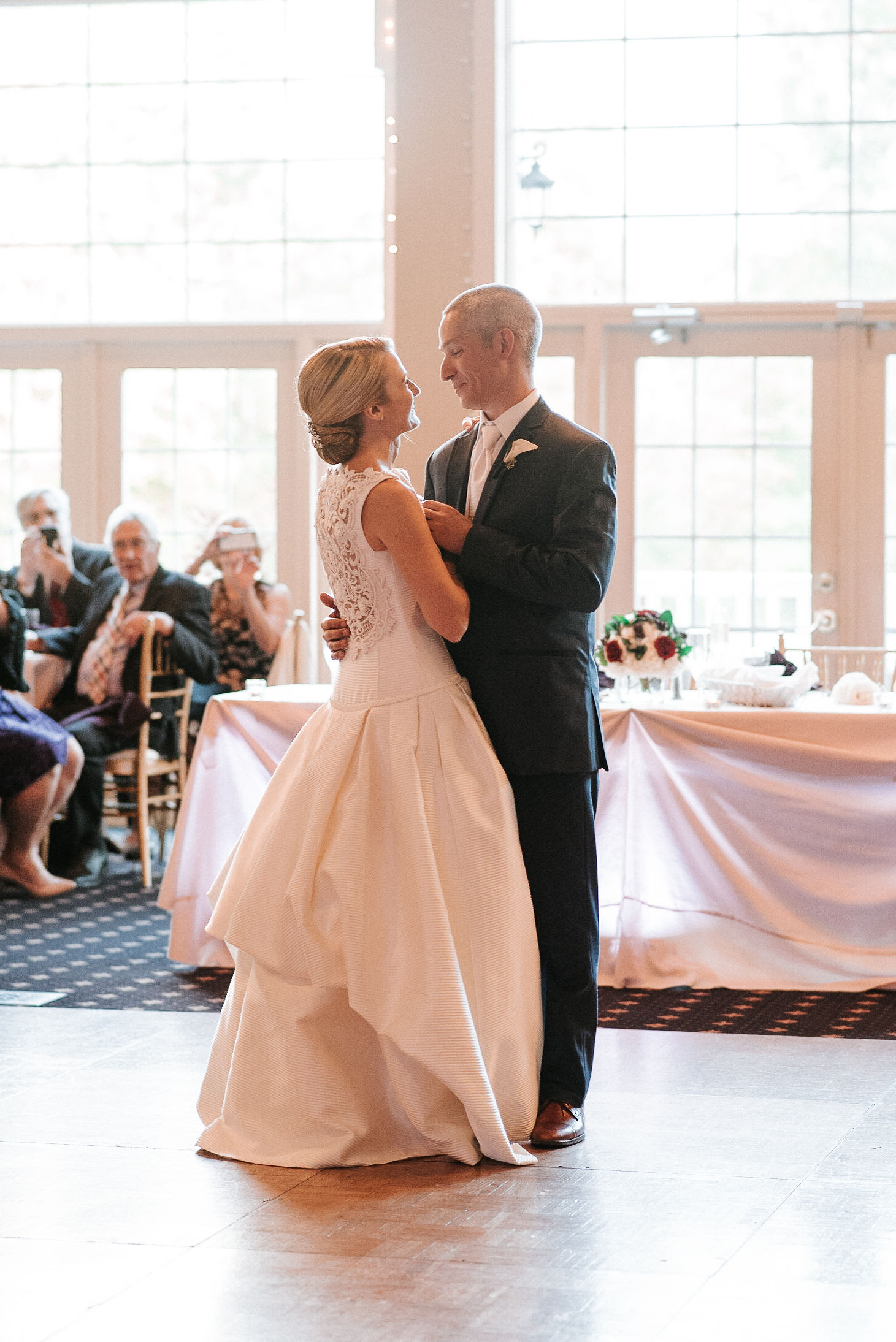 bride and groom having first dance at St. Mark Orthodox Church