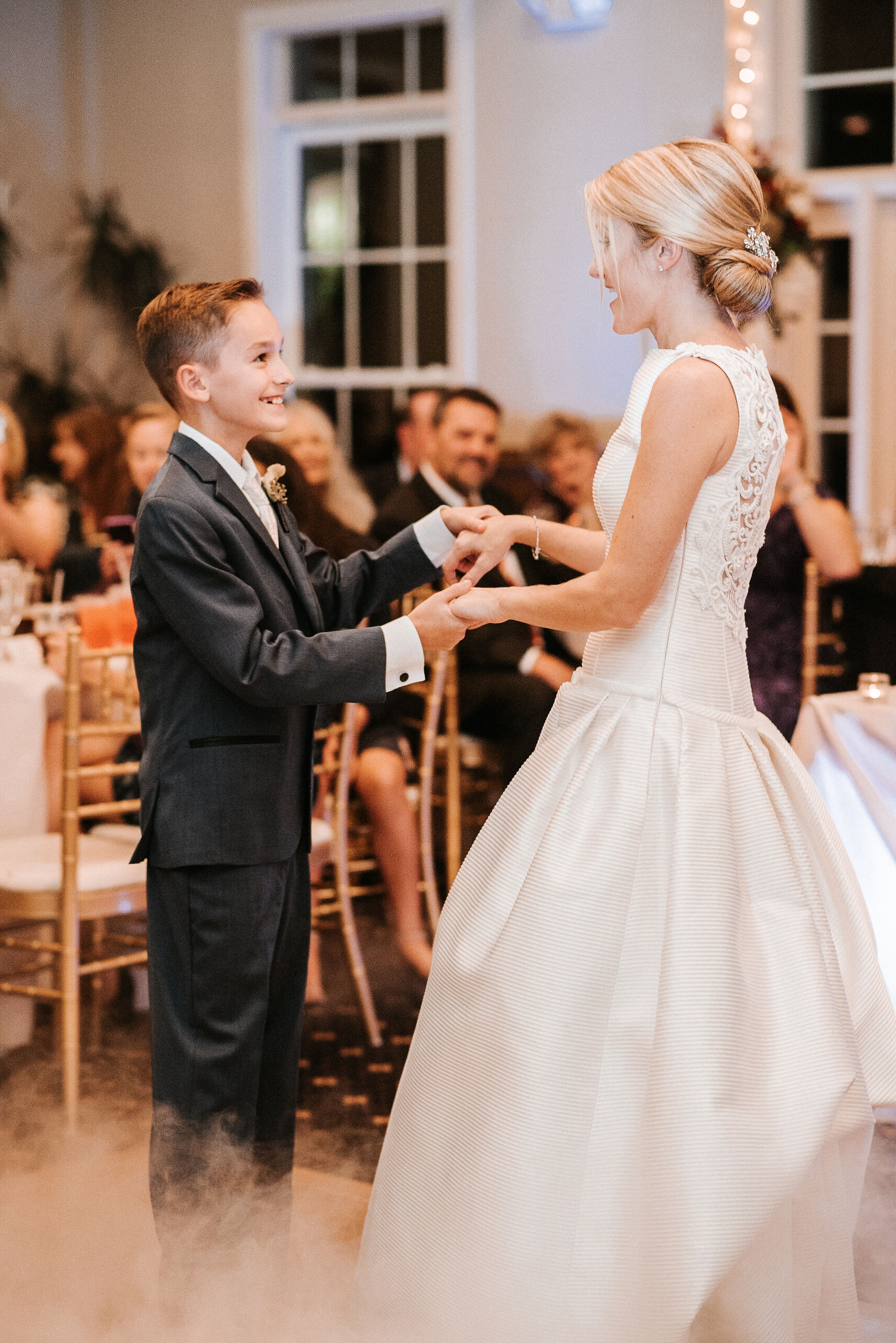 bride and step-son dancing at reception at St. Mark Orthodox Church