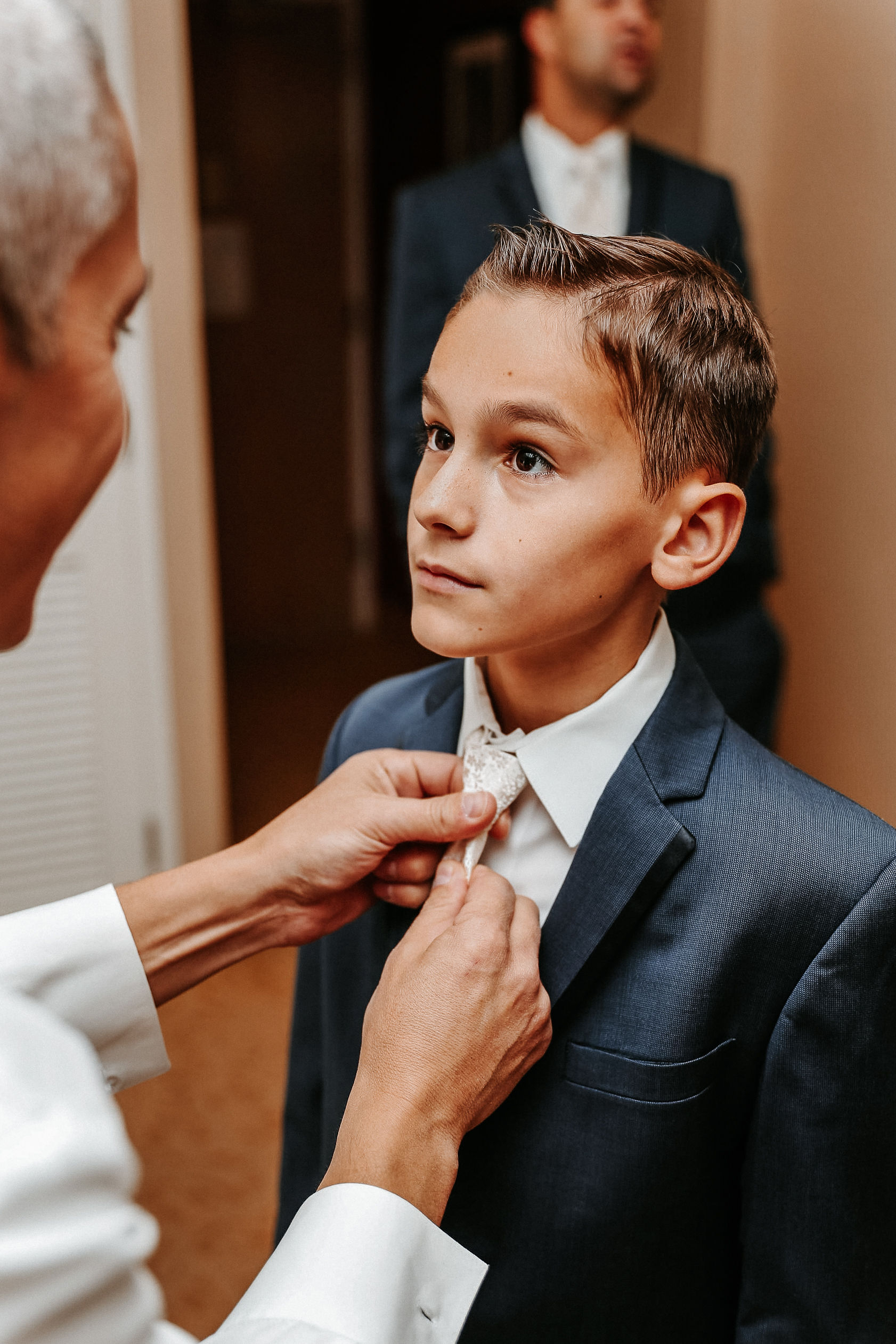 groom helping son get ready at St. Mark Orthodox Church