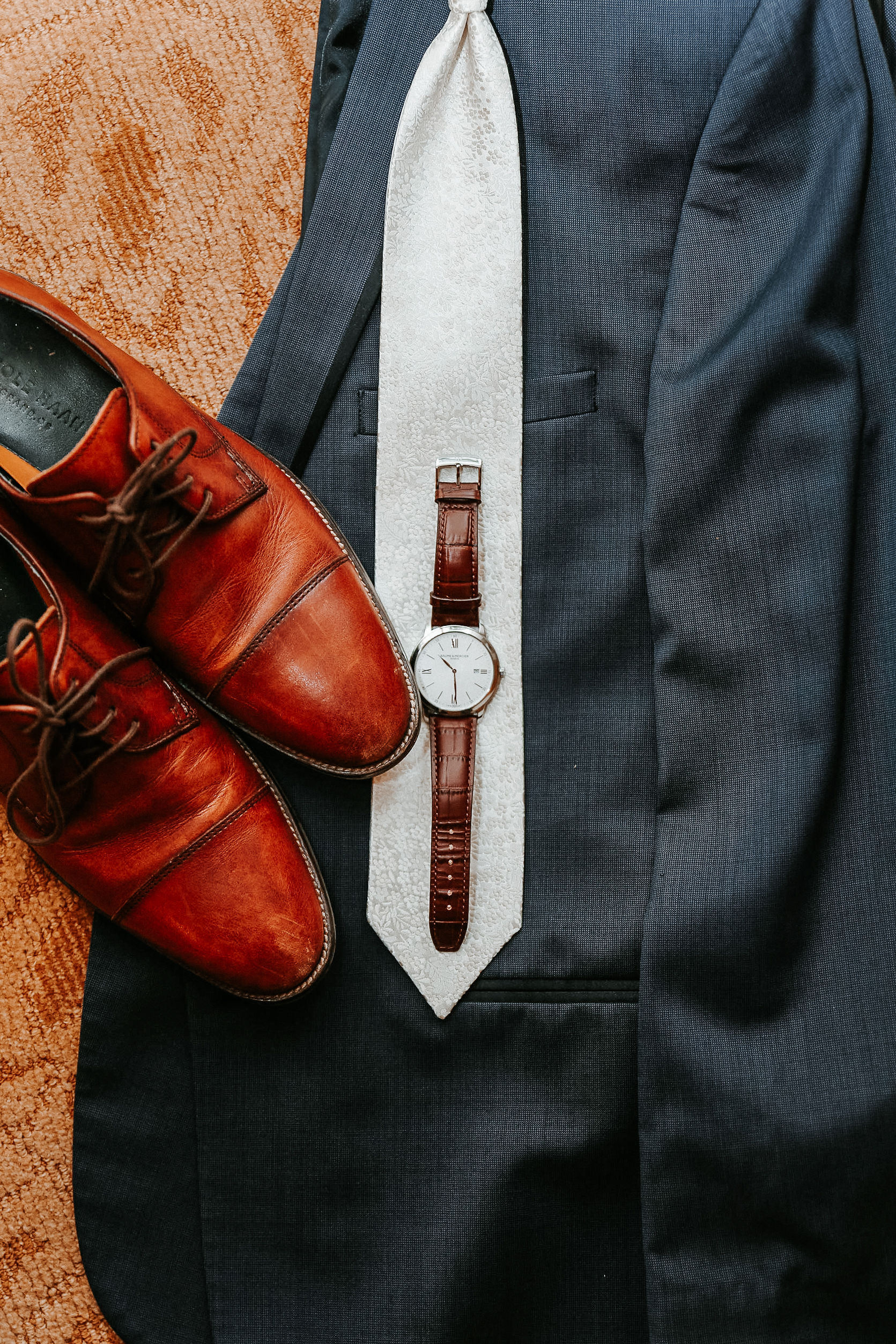 detail shots of groom's shoes, tie, and watch at St. Mark Orthodox Church