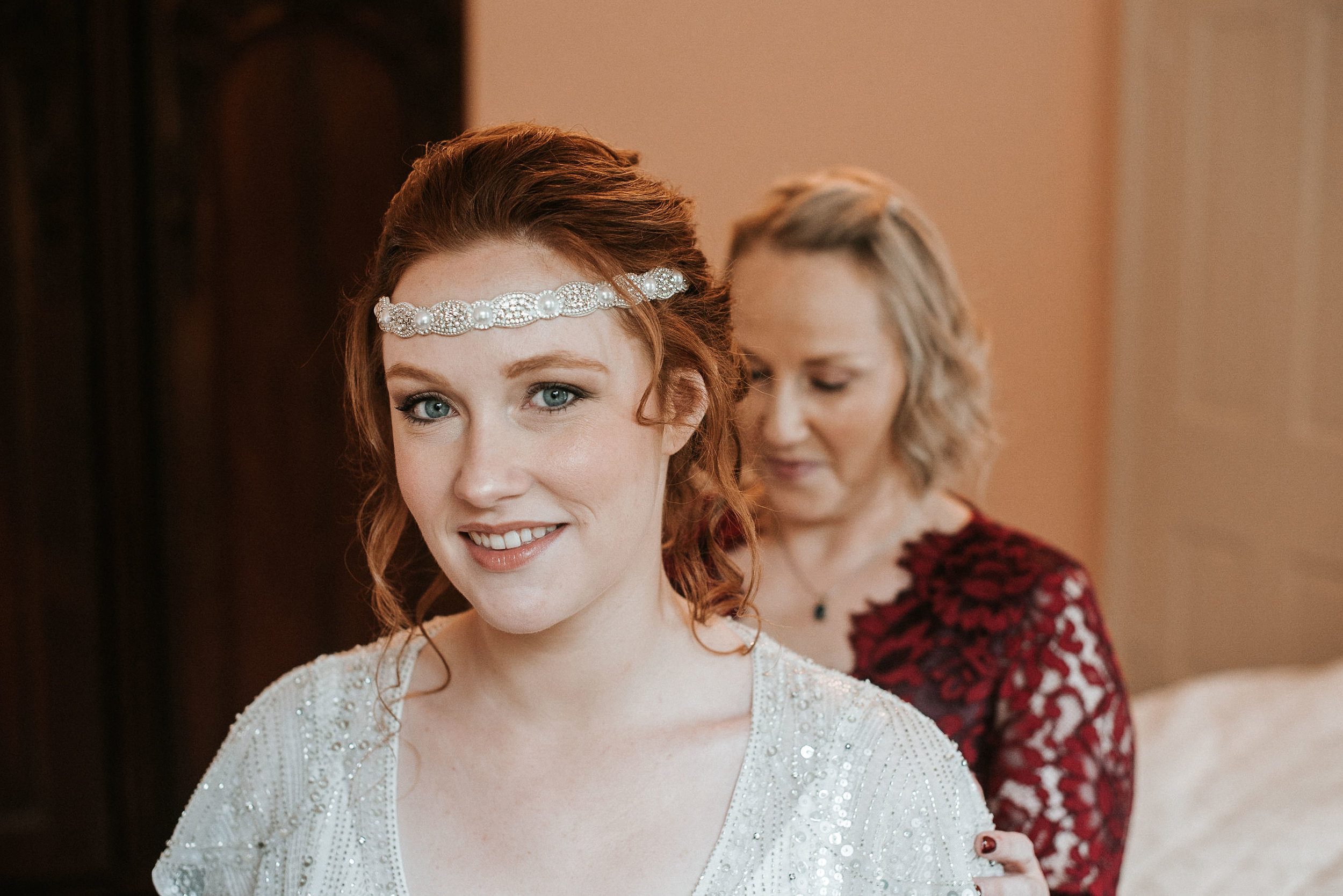 bride smiling as she gets in her wedding dress at Braehead Manor