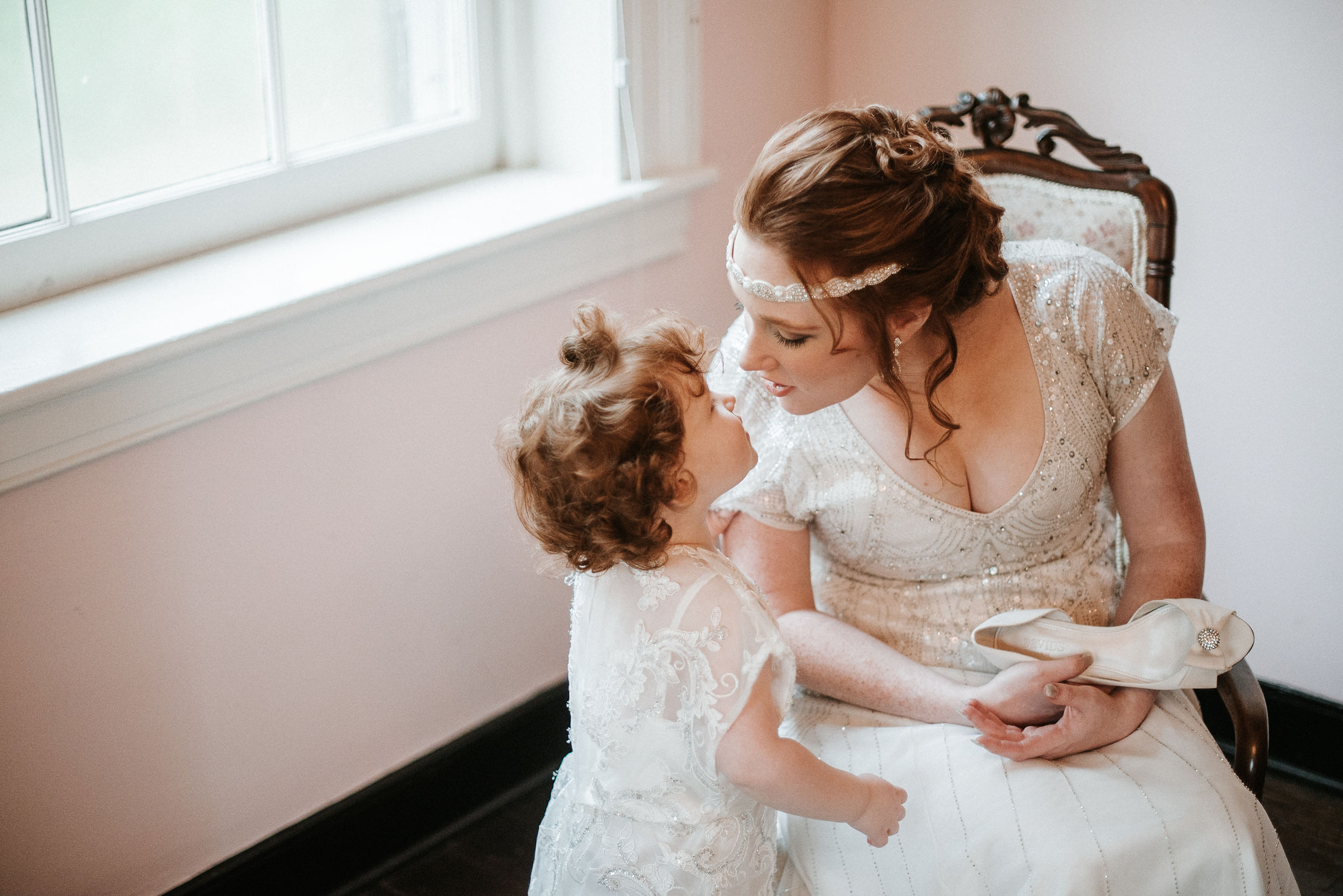bride talking to flower girl at Braehead Manor