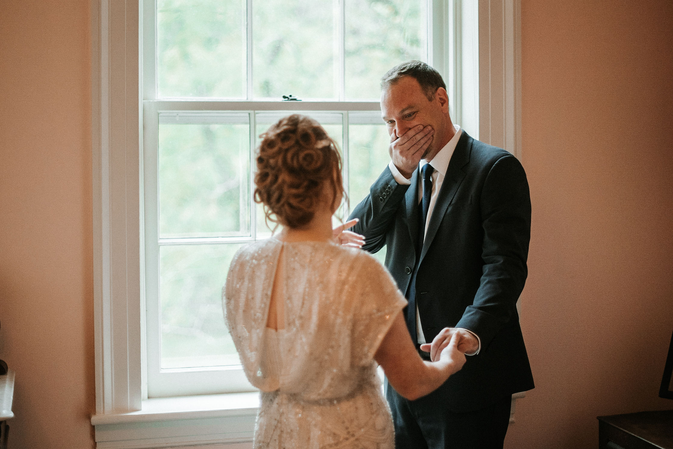 bride and father of the bride do a first look at Braehead Manor