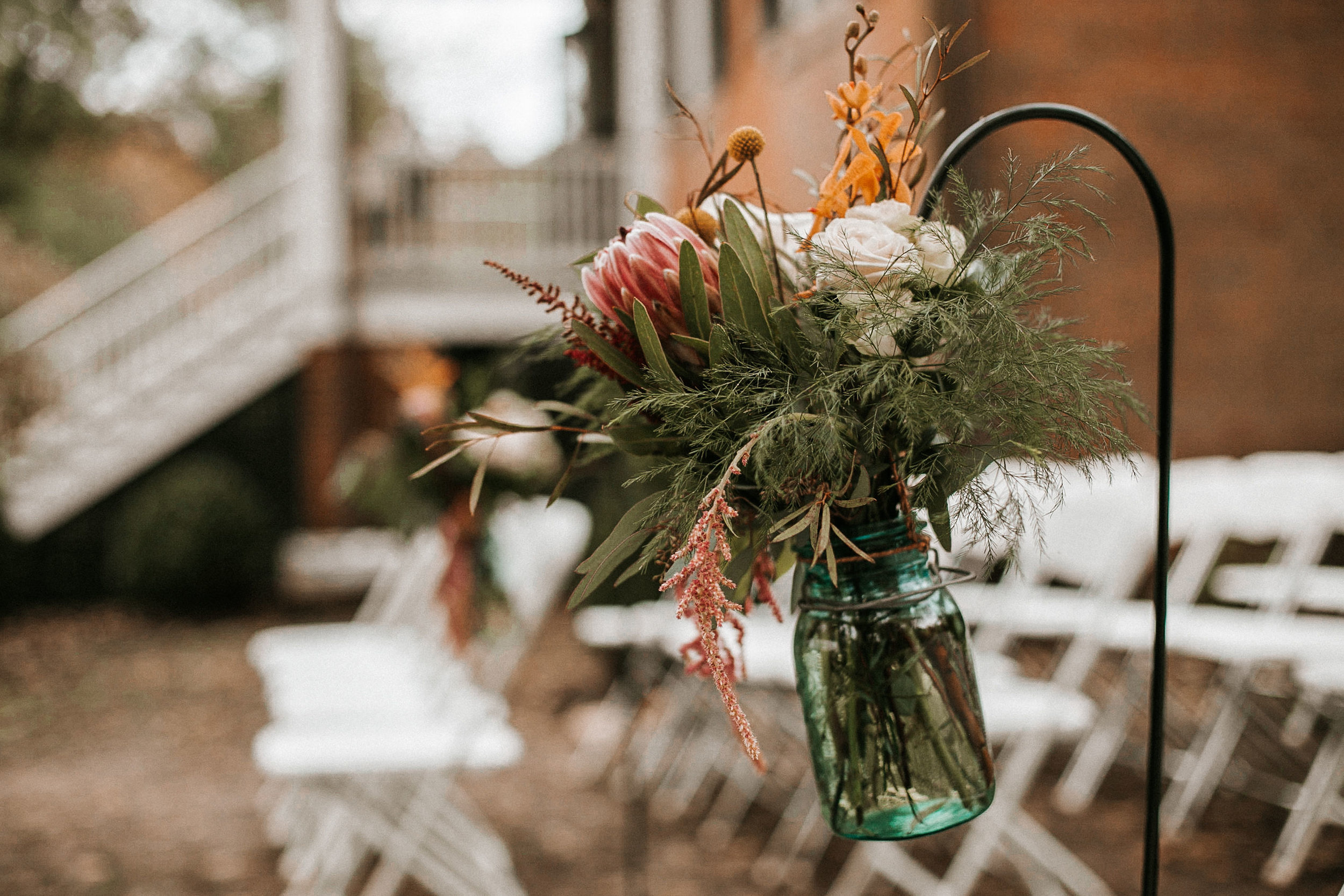 detail shot of flowers at ceremony site at Braehead Manor
