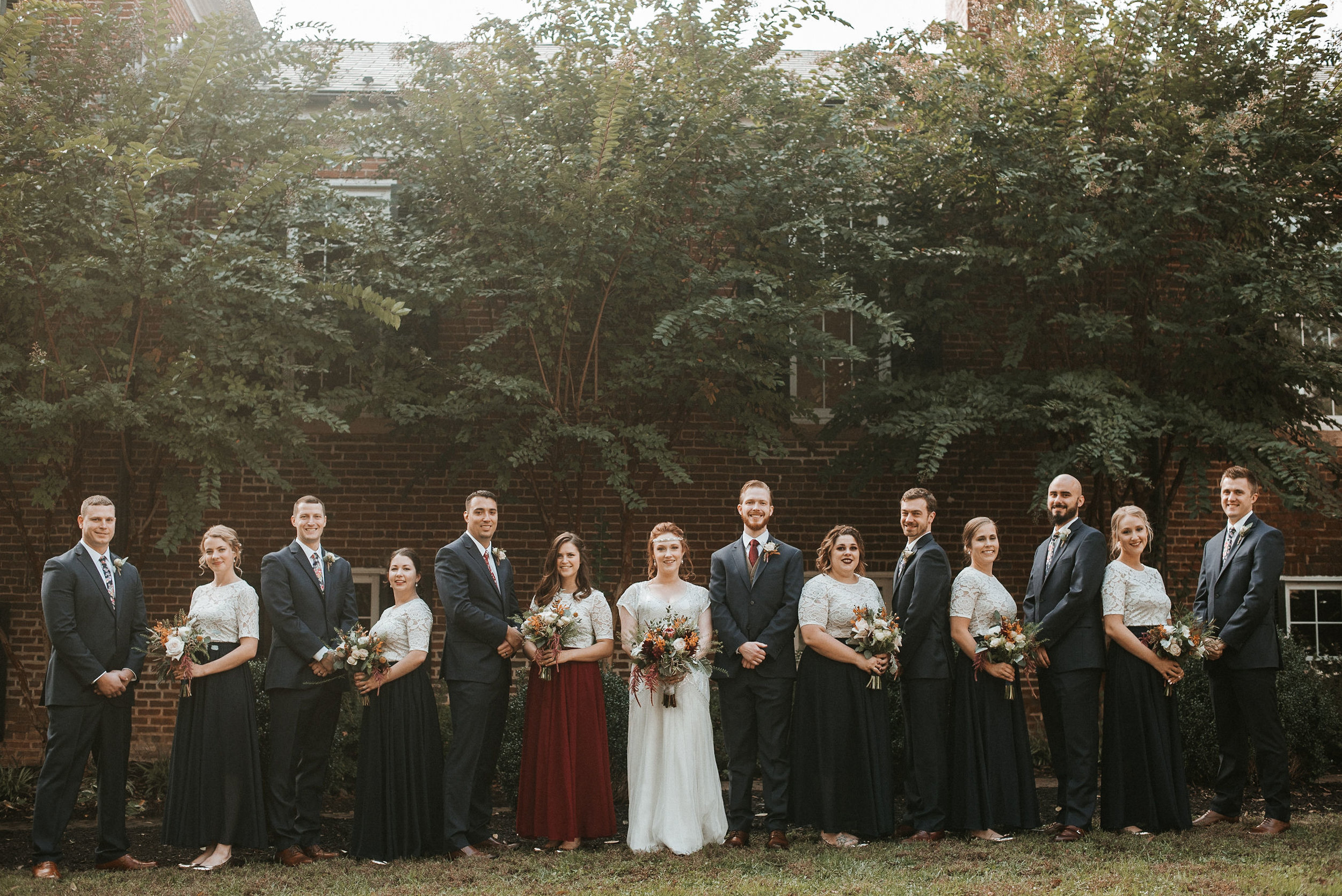 wedding party posing at Braehead Manor