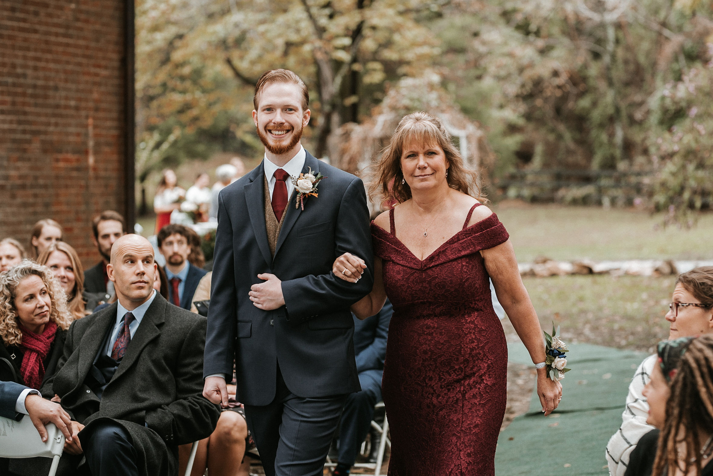 groom and his mother walking down the aisle at Braehead Manor