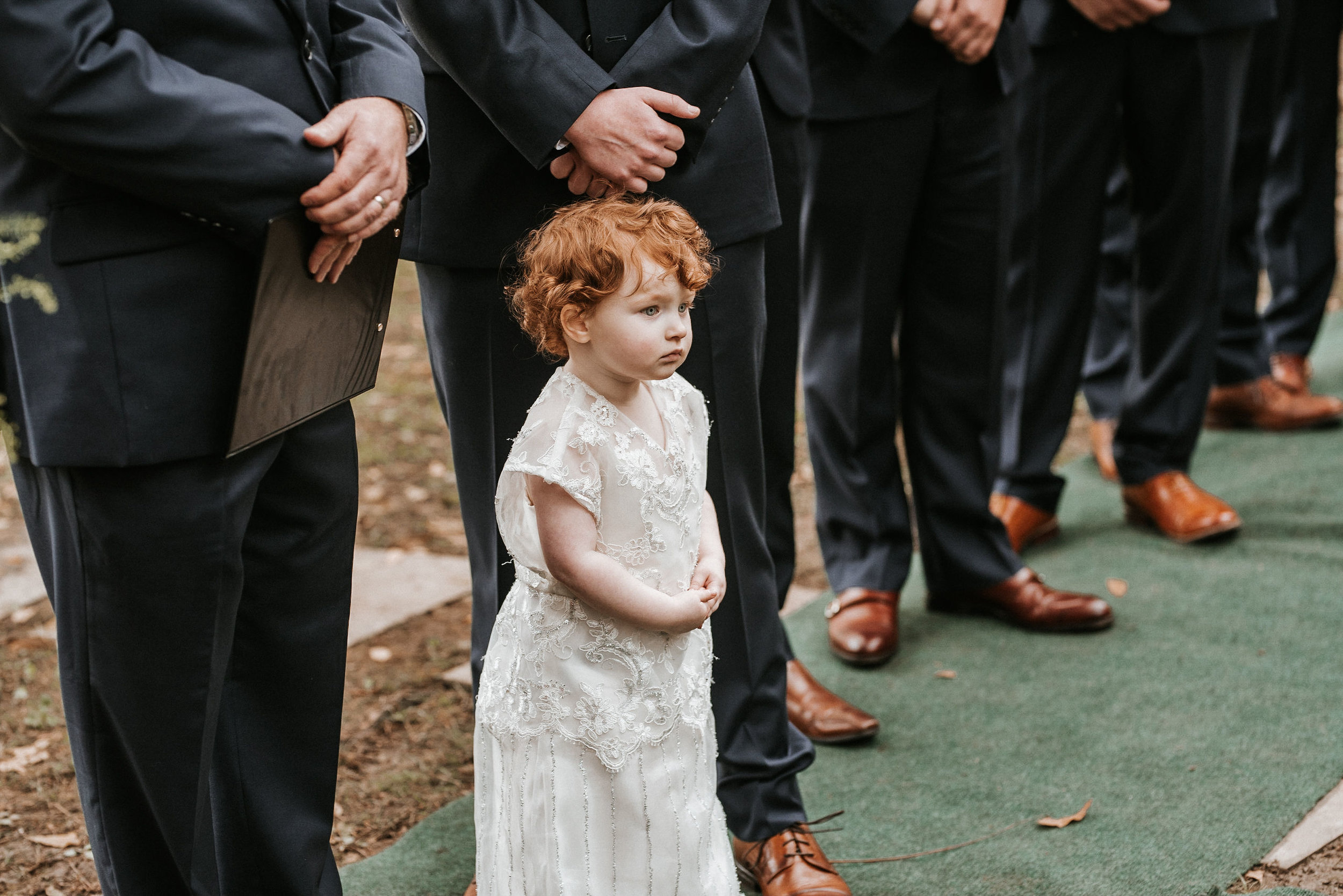 flower girl standing next to groom at Braehead Manor