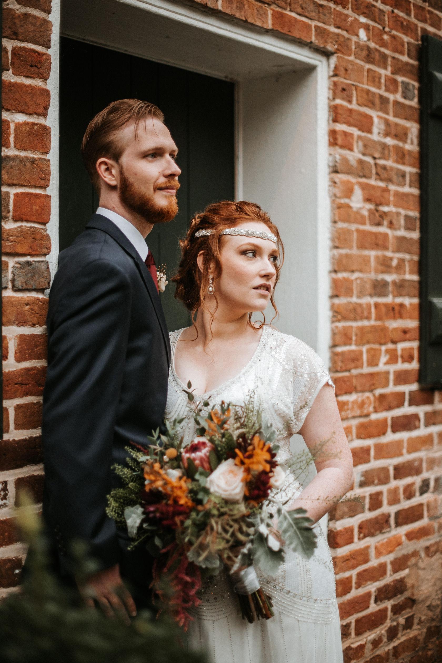 bride and groom looking away at Braehead Manor