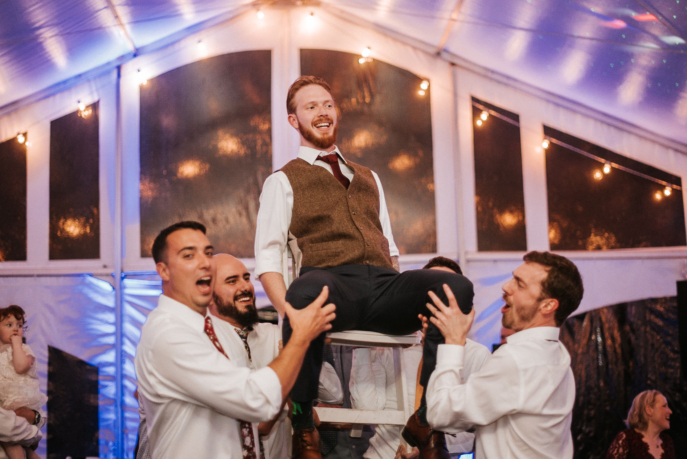 groom being lifted by groomsmen at Braehead Manor