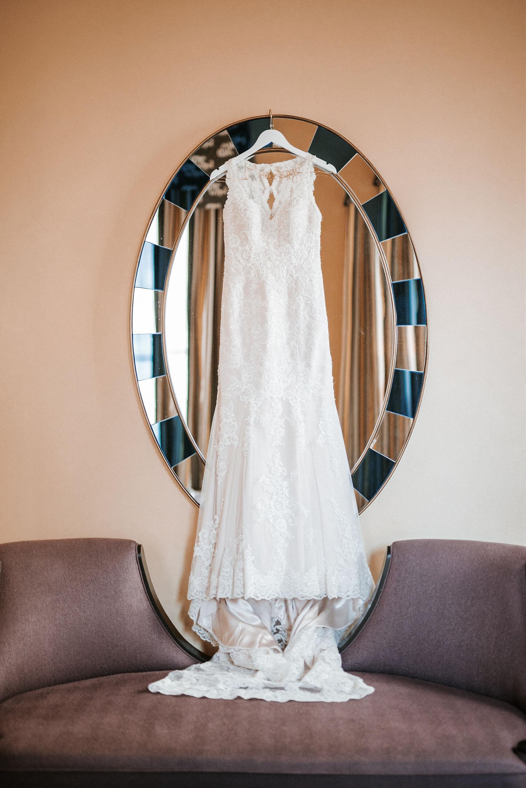 detail shot of bride's wedding dress at Hotel Monaco