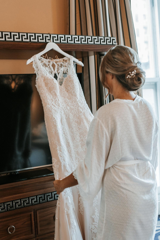 bride admiring dress at Hotel Monaco