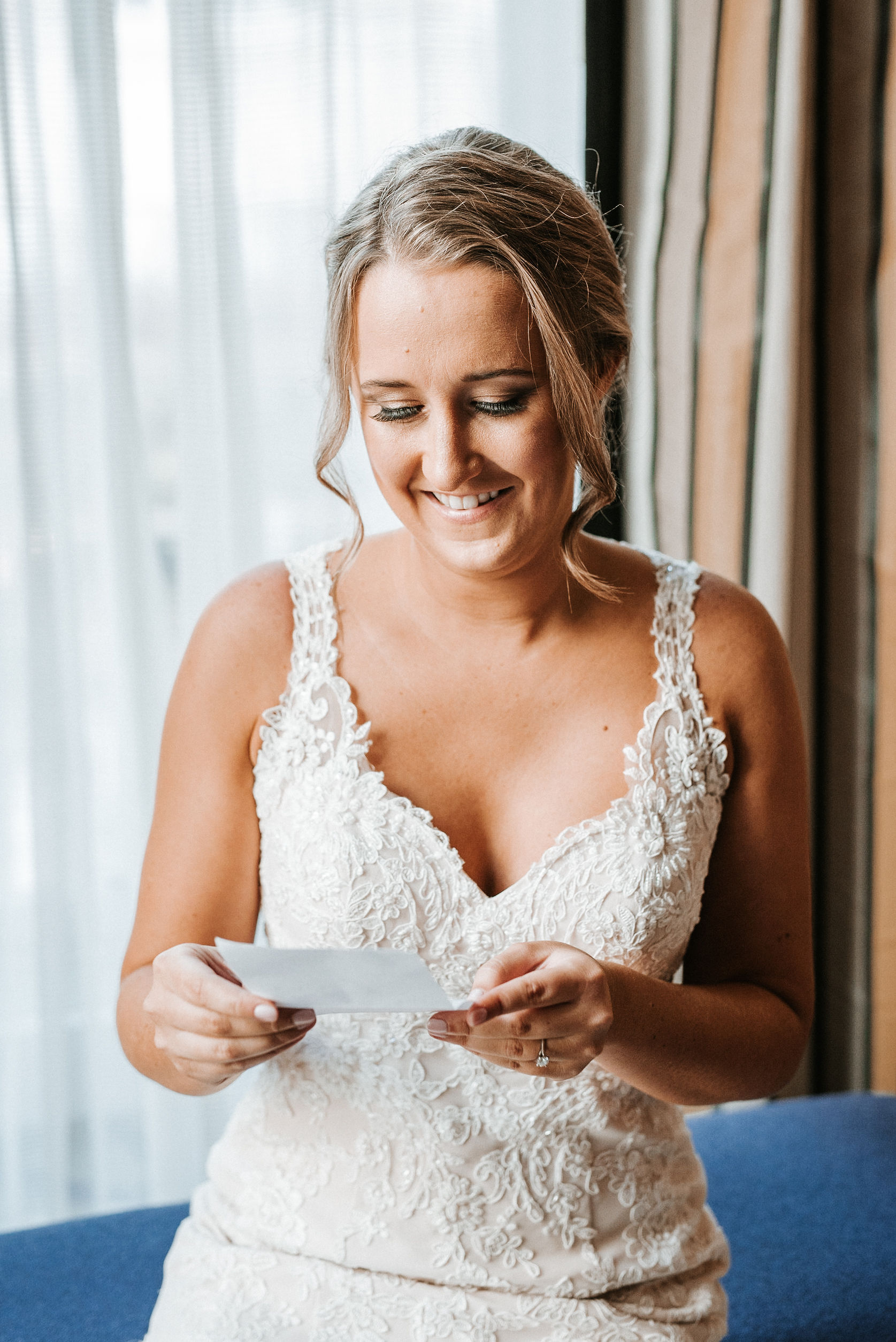 bride reading letter from groom at Hotel Monaco