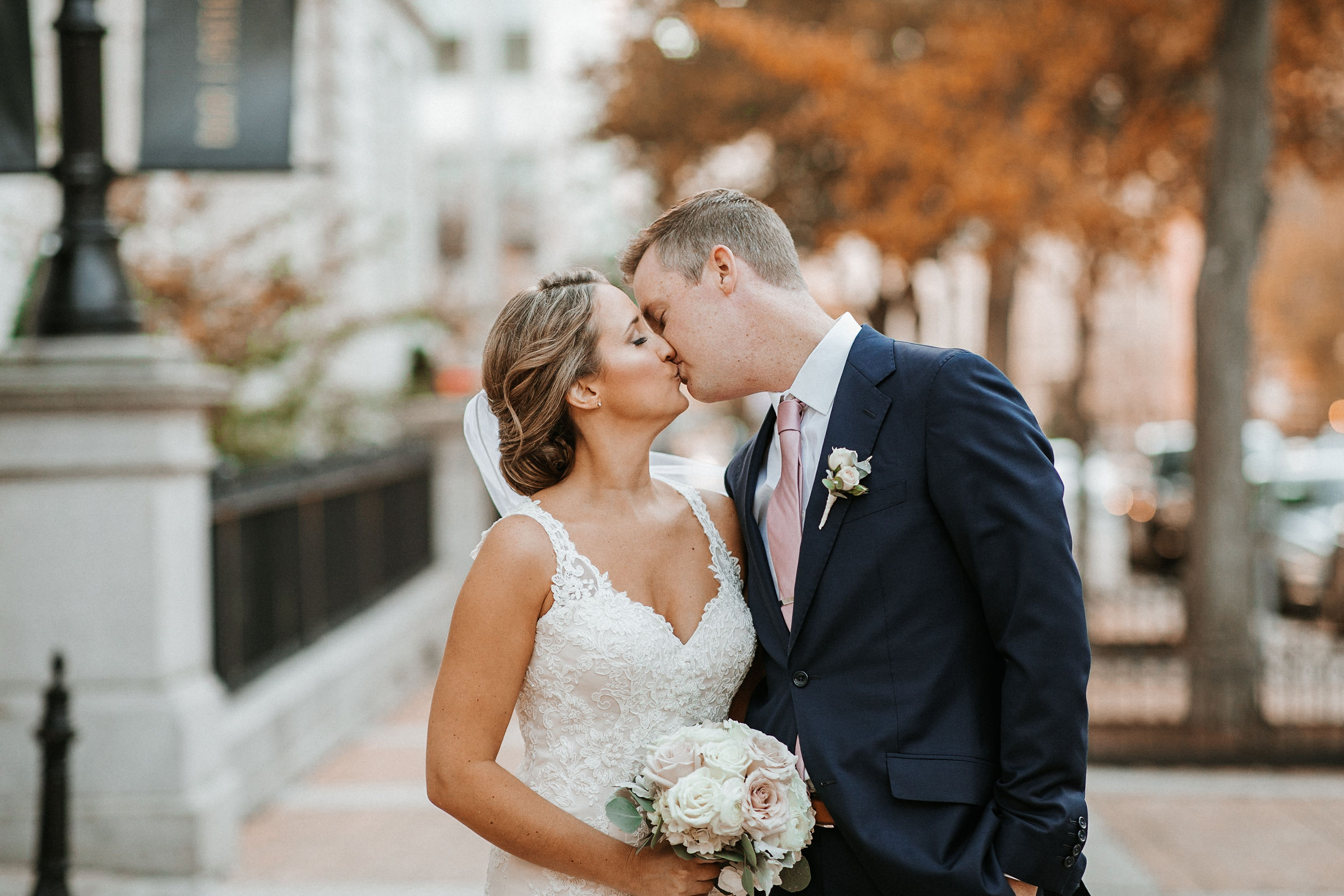 bride and groom kissing at Hotel Monaco