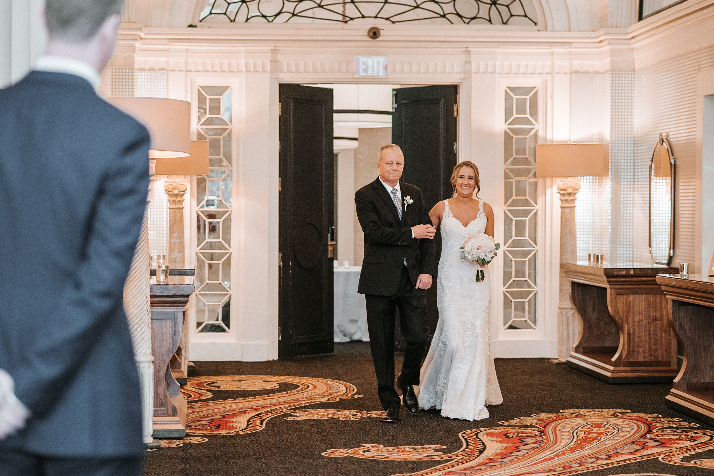 bride walking up the aisle at Hotel Monaco