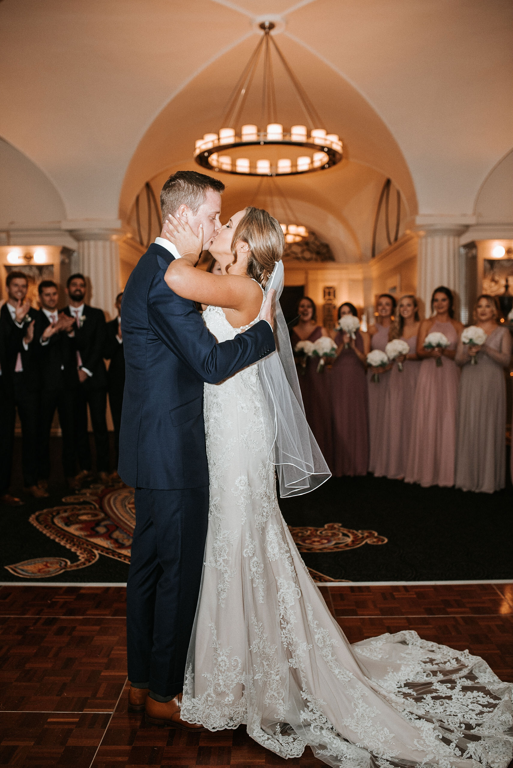 bride and groom kissing at the alter at Hotel Monaco