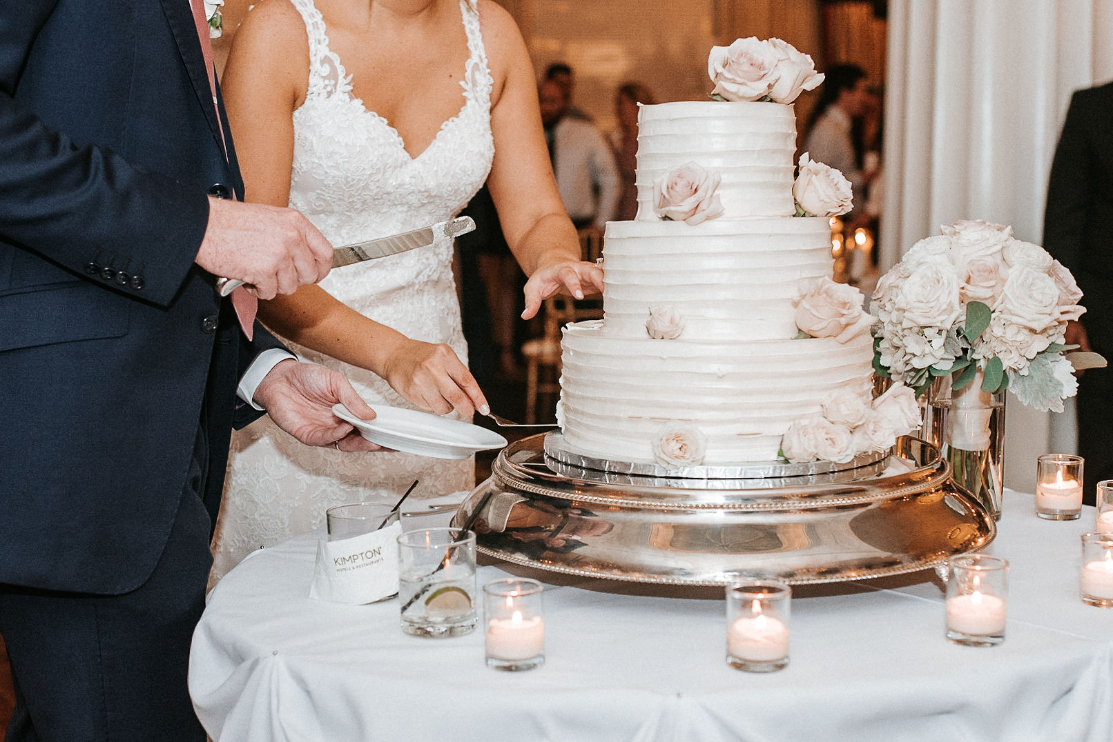 bride and groom cutting the cake at Hotel Monaco