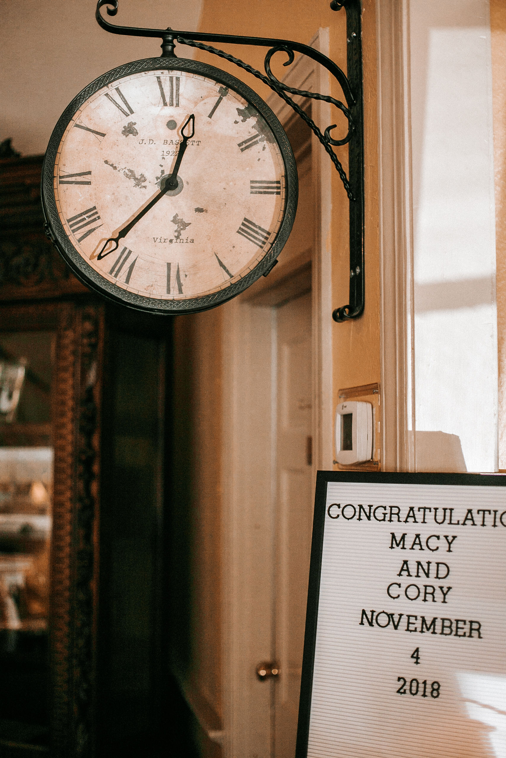 detail shot of clock and wedding sign at the inn at the silk mill