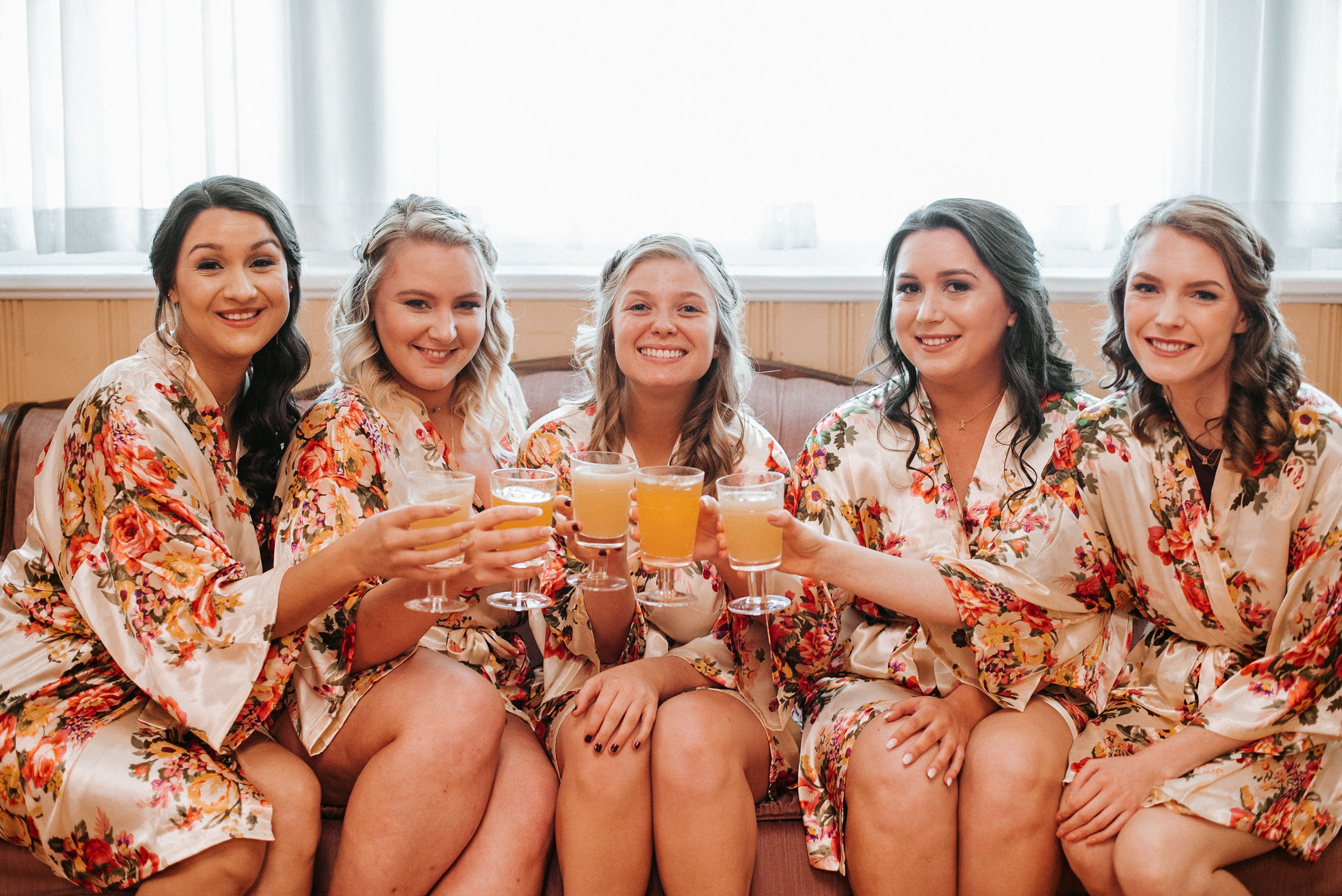 bride and bridesmaids drinking at the inn at the silk mill