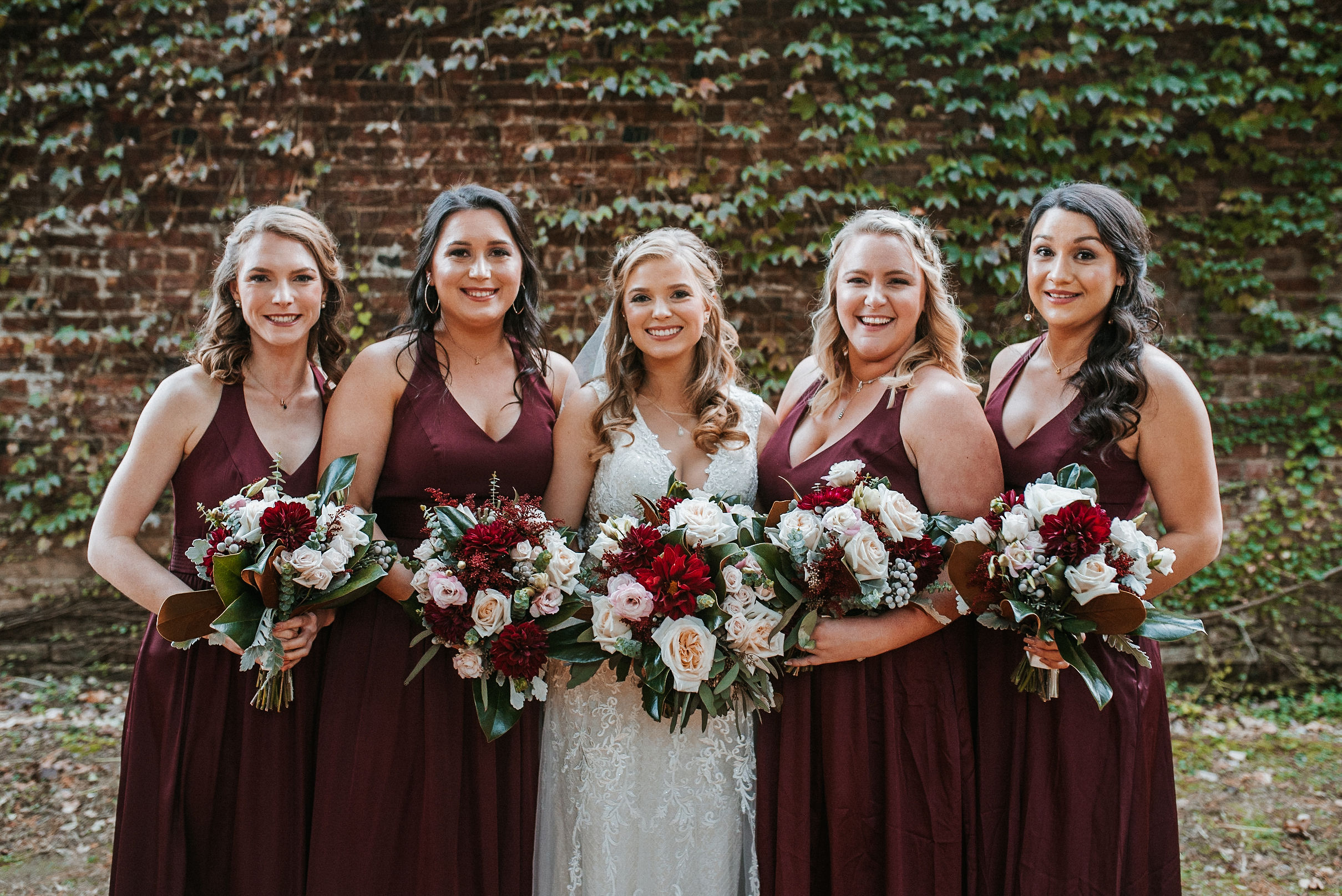bridal party smiling at the inn at the silk mill