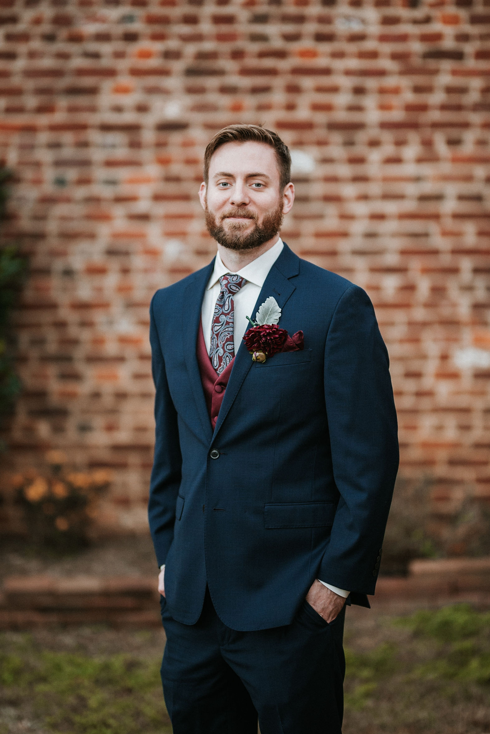 groom portrait at the inn at the silk mill