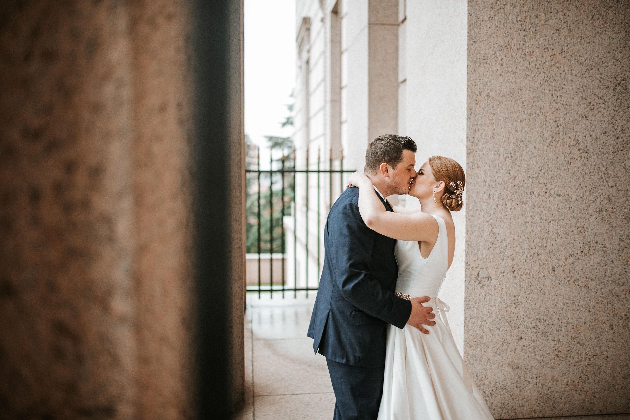 bride and groom kissing at The George Washington Masonic National Memorial