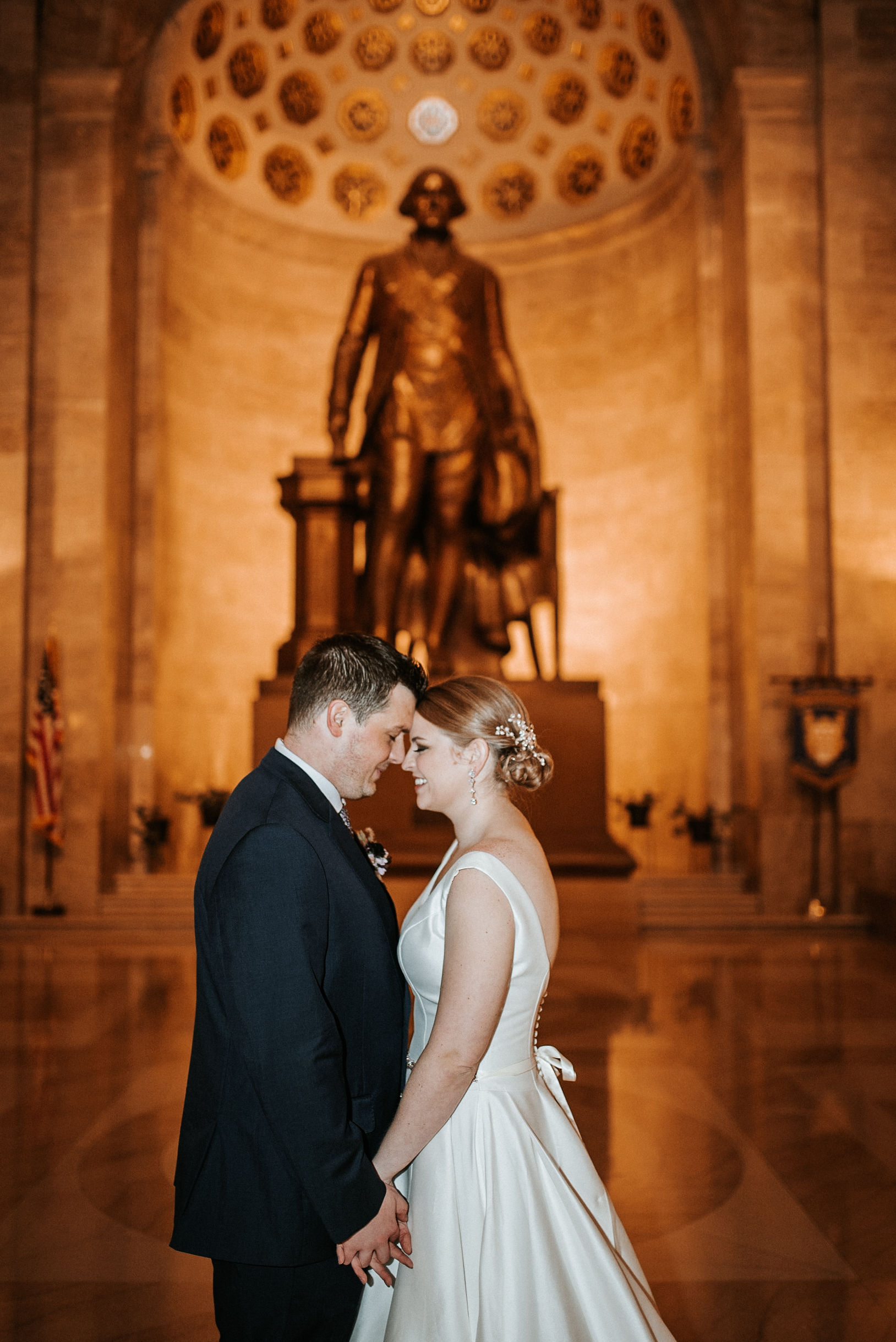 bride and groom embracing at The George Washington Masonic National Memorial