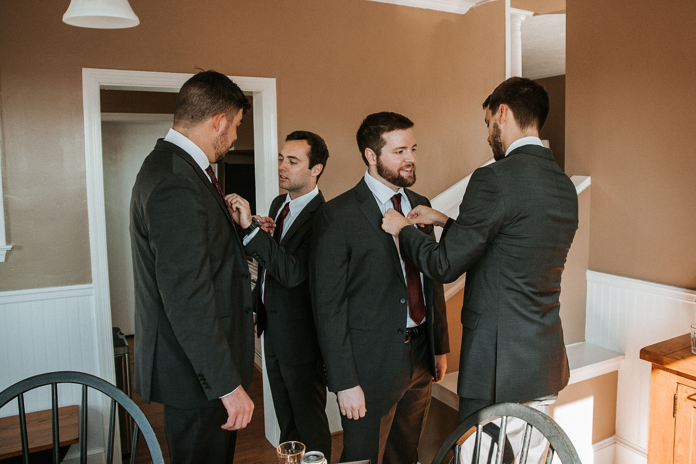 groom and groomsmen getting ready at the middleburg barn at fox chase farm
