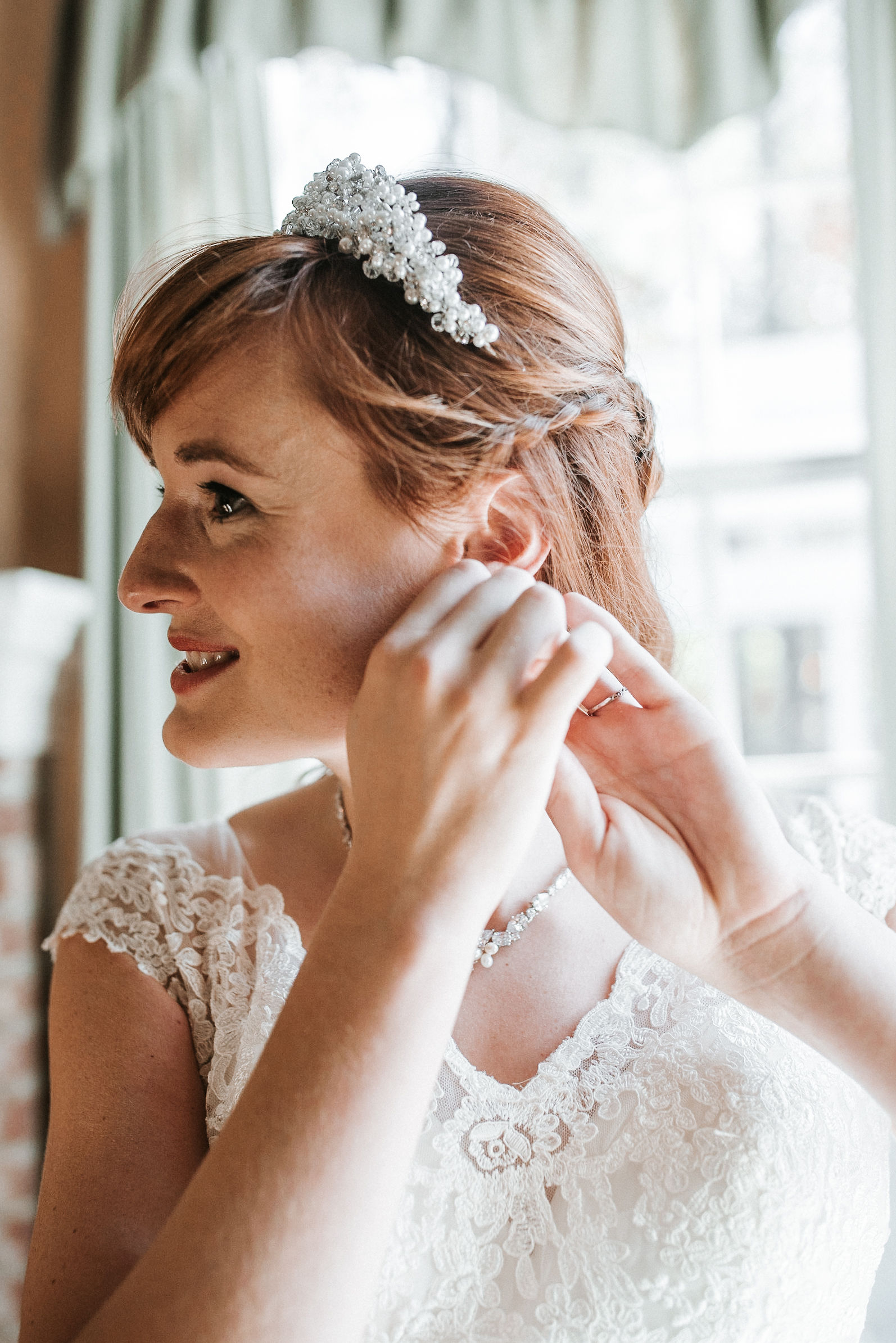 bride putting on earrings at the middleburg barn at fox chase farm
