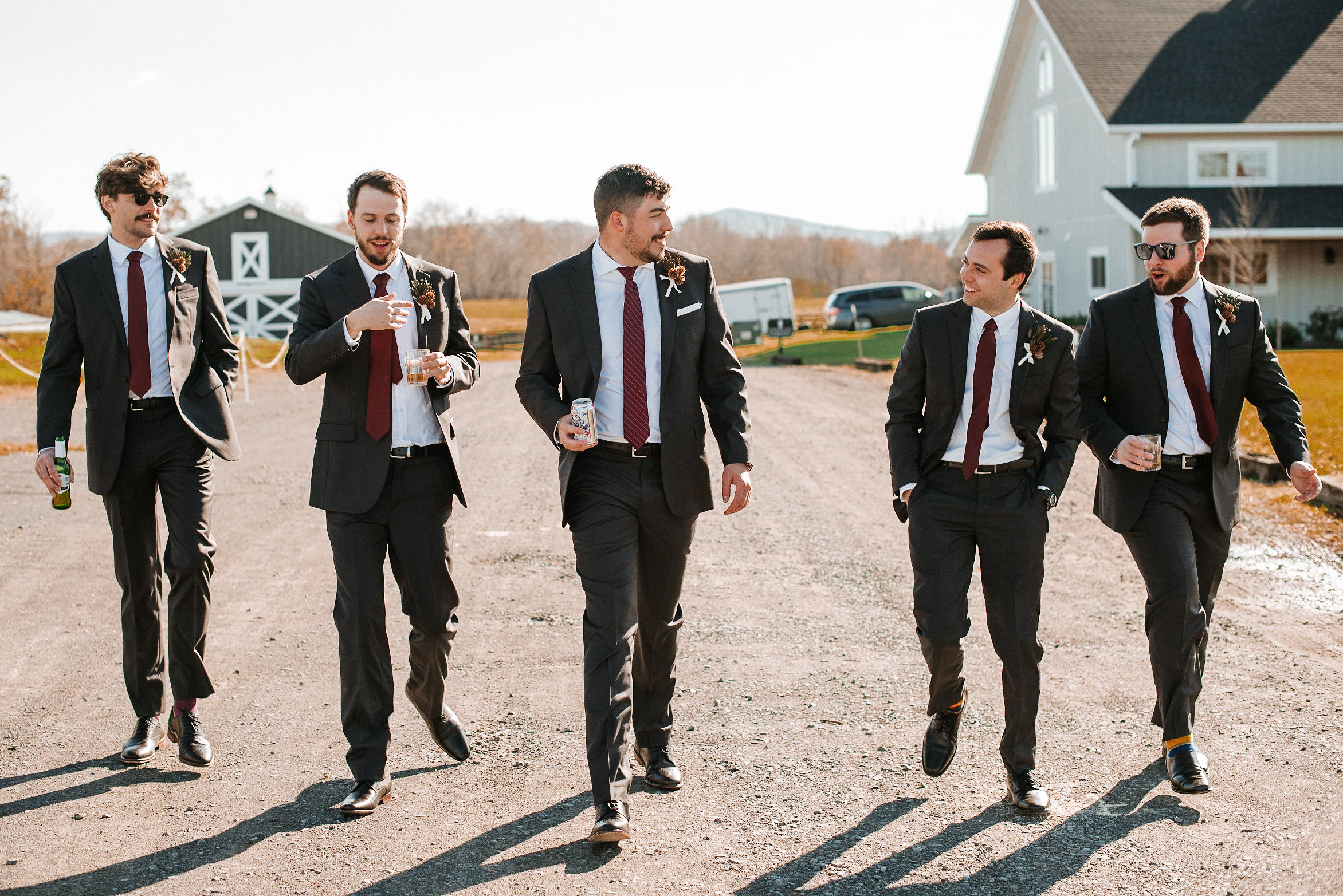 groom and groomsmen walking at the middleburg barn at fox chase farm