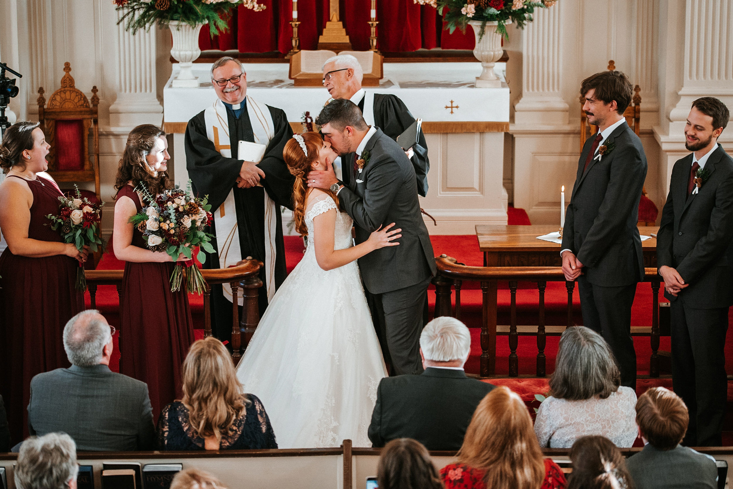 bride and groom kissing at the Middleburg United Methodist Church