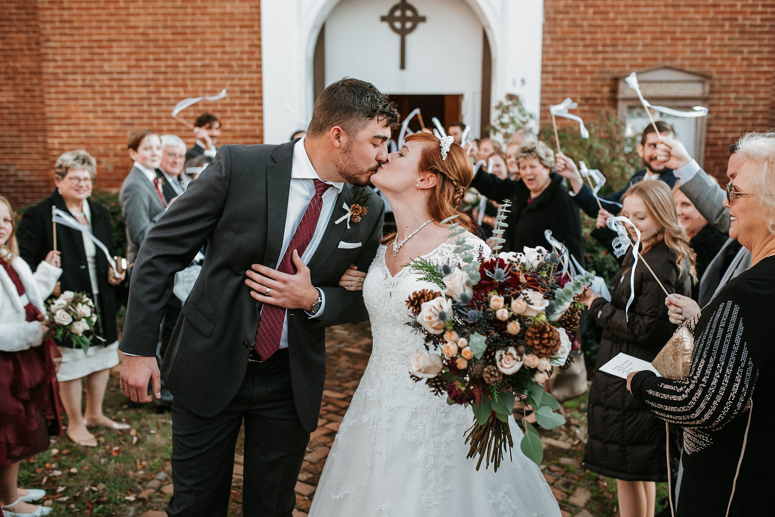 bride and groom kissing as the leave church at the Middleburg United Methodist Church