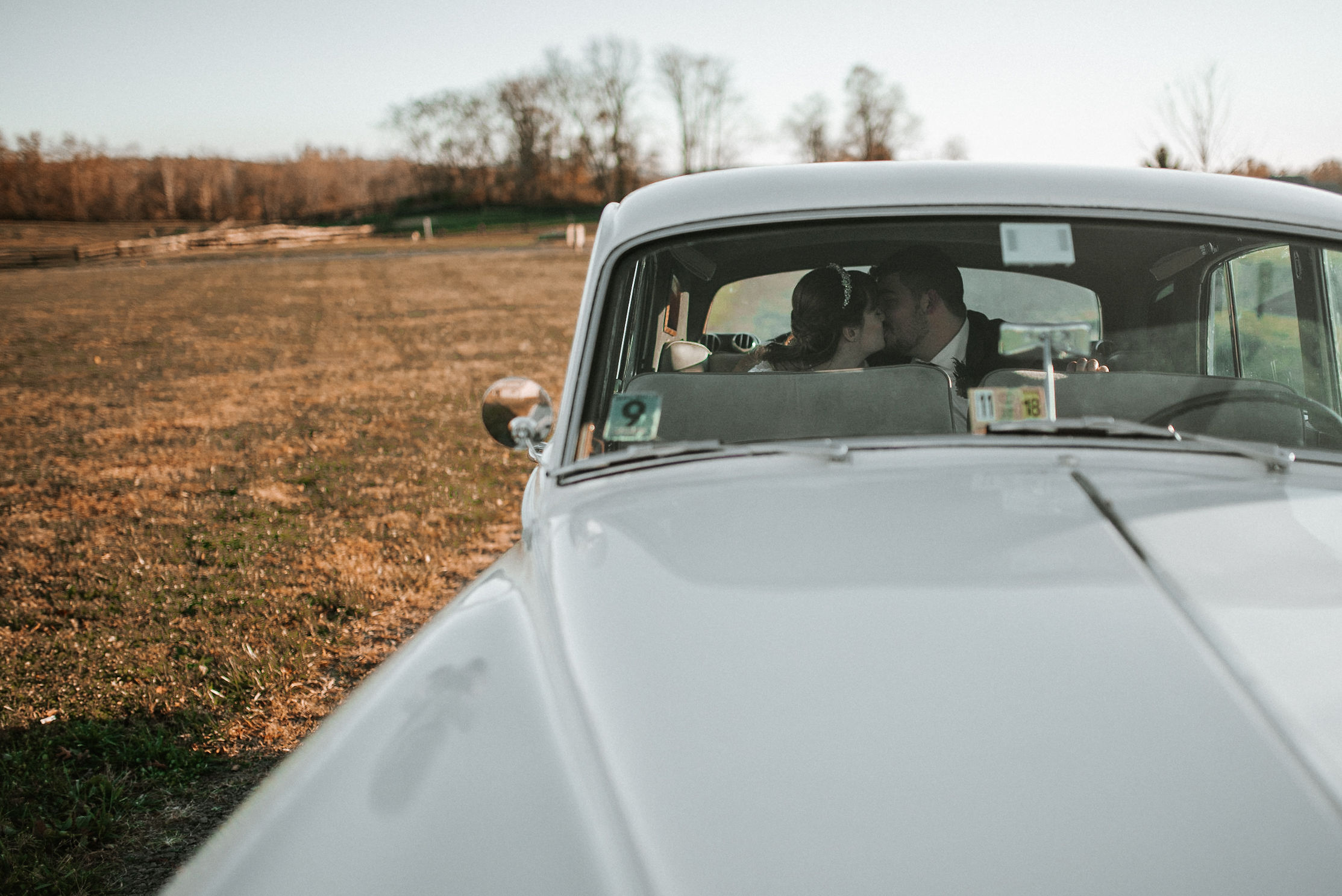 bride and groom kissing inside car at The Middleburg Barn at Fox Chase Farm