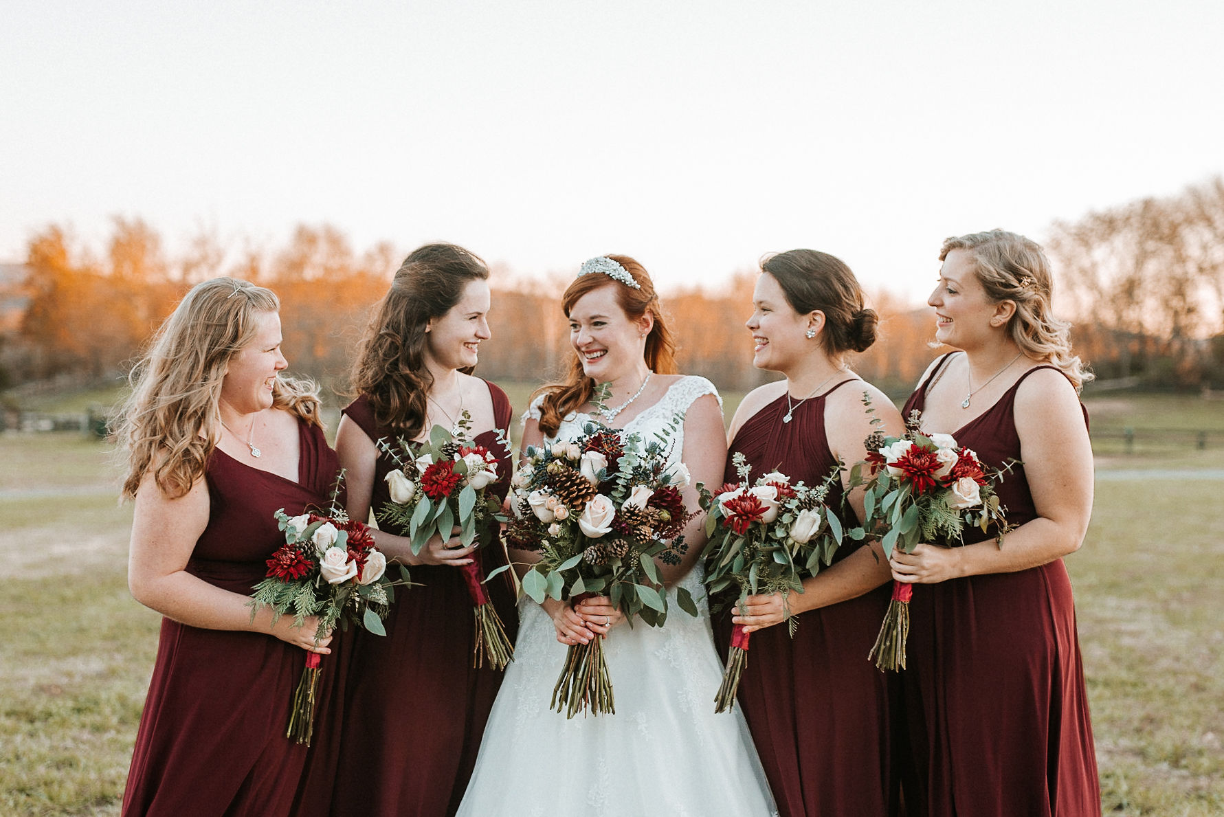 bridesmaids and bride smiling at The Middleburg Barn at Fox Chase Farm