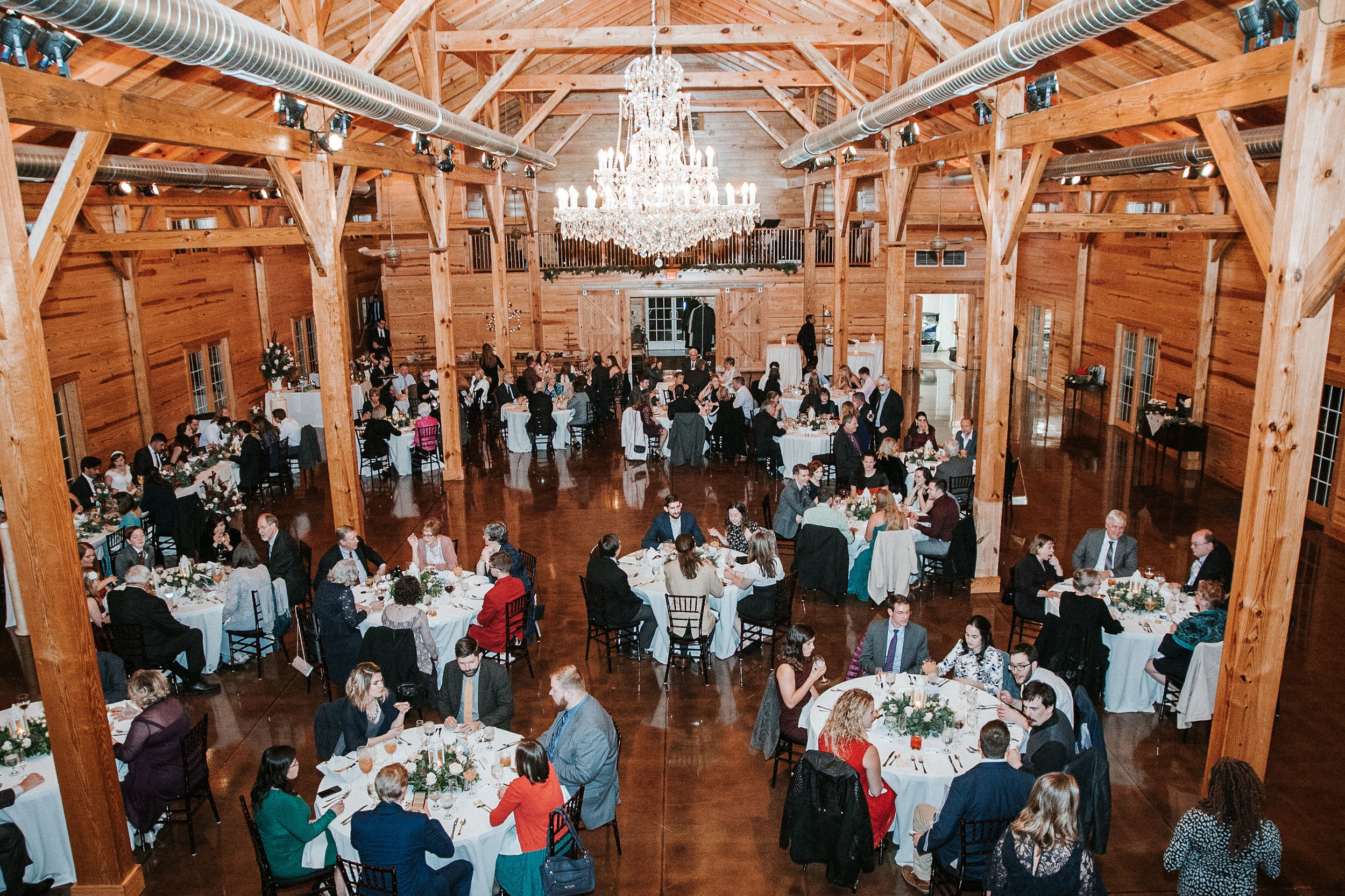 guests inside reception at The Middleburg Barn at Fox Chase Farm