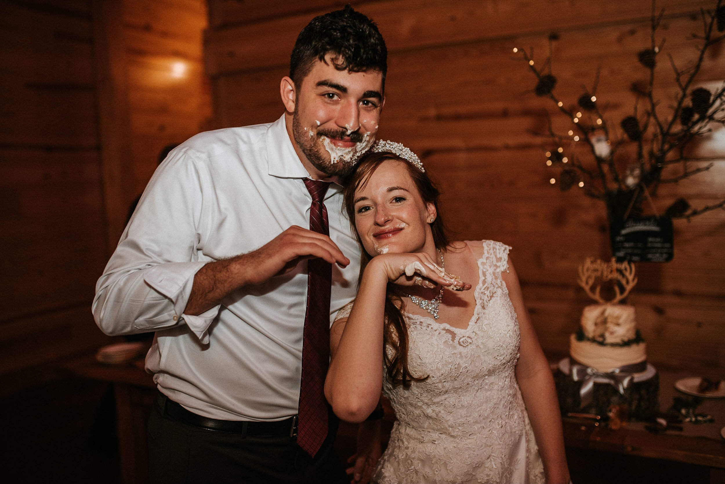 bride and groom smiling with cake on face at The Middleburg Barn at Fox Chase Farm