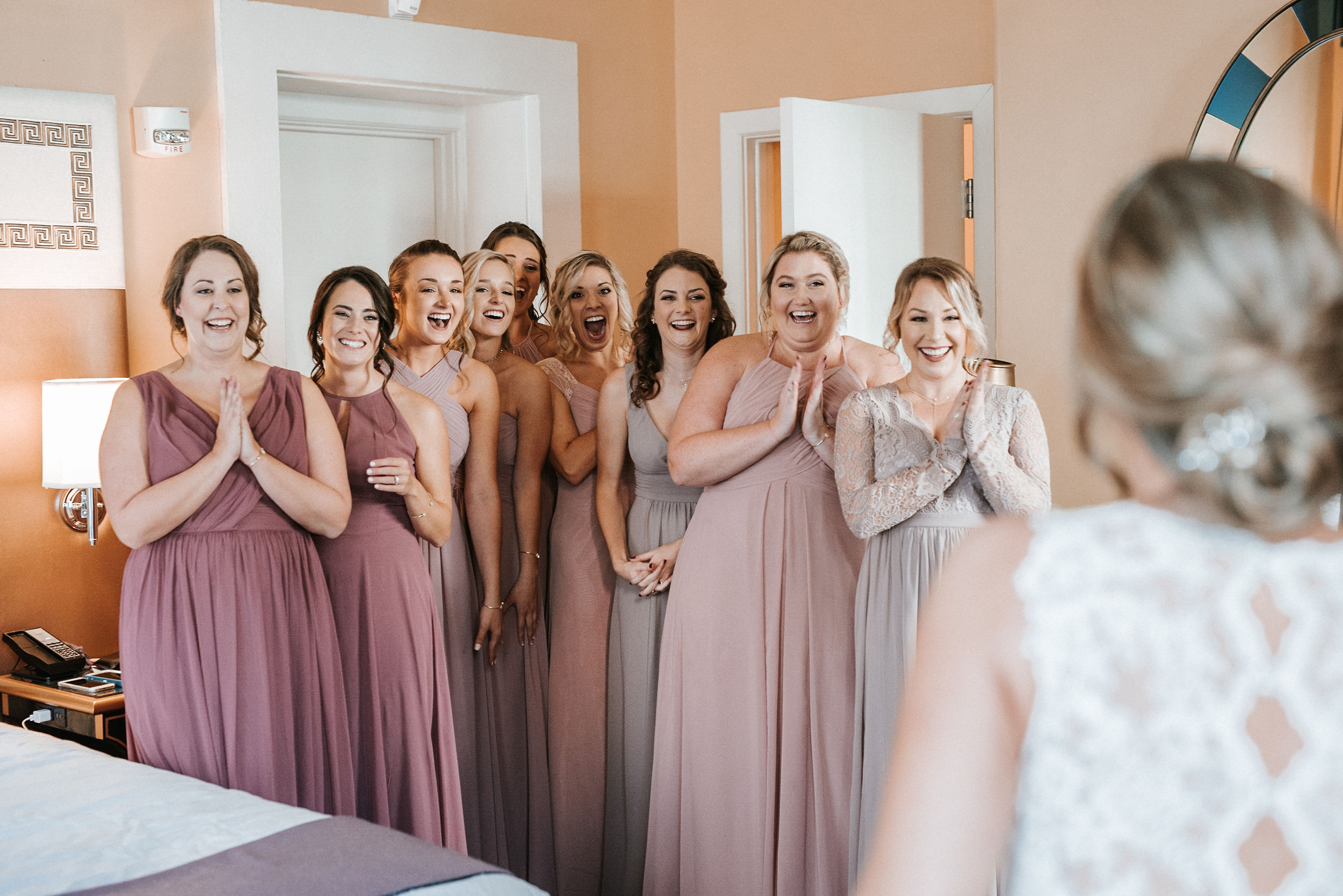 bride doing a first look with bridesmaids