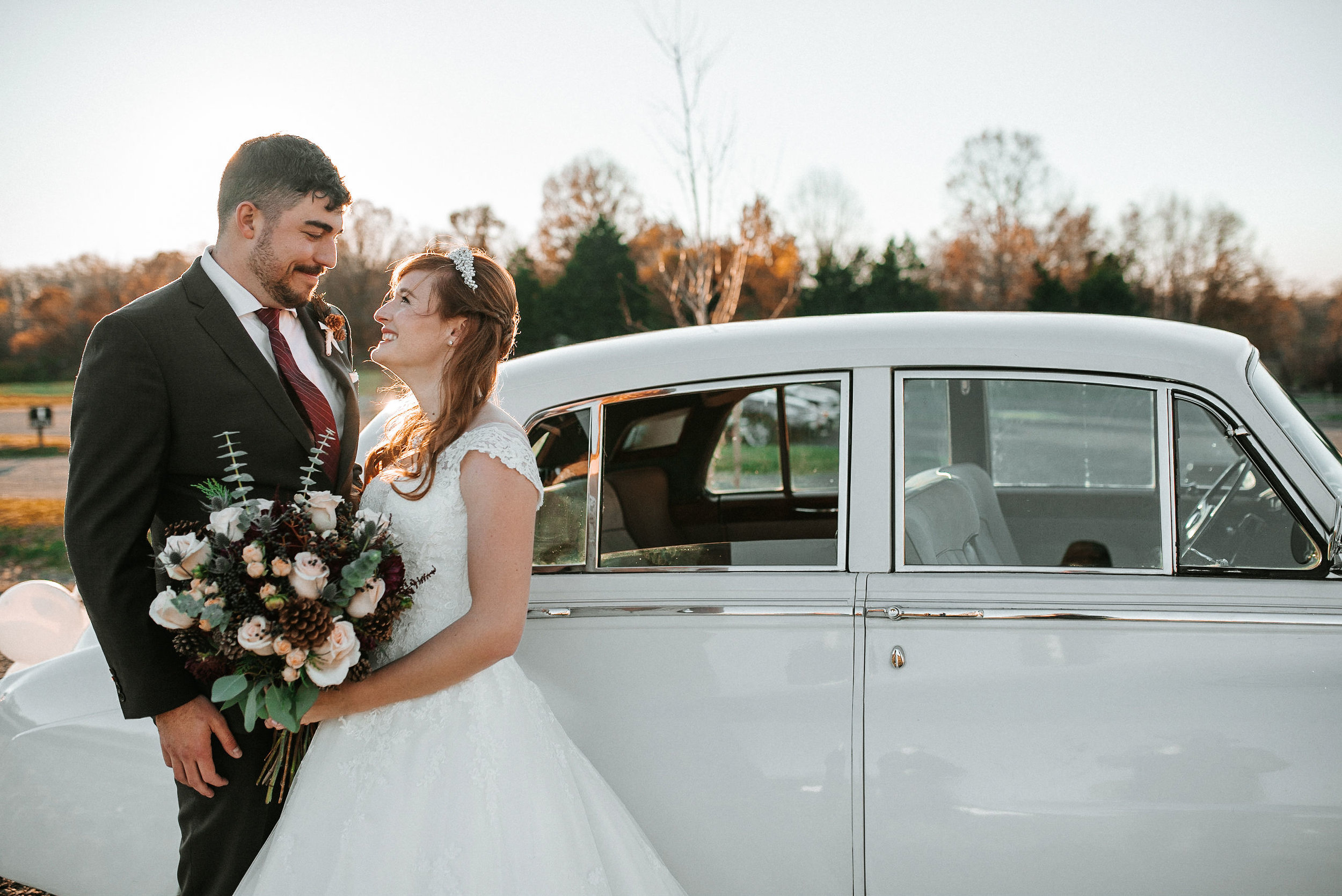 bride and groom smiling at the middleburg barn