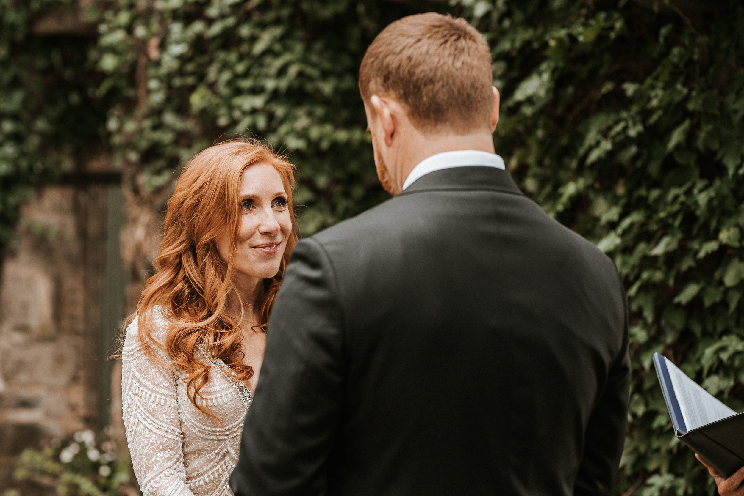 bride looking at groom at the altar Goodstone Inn & Restaurant