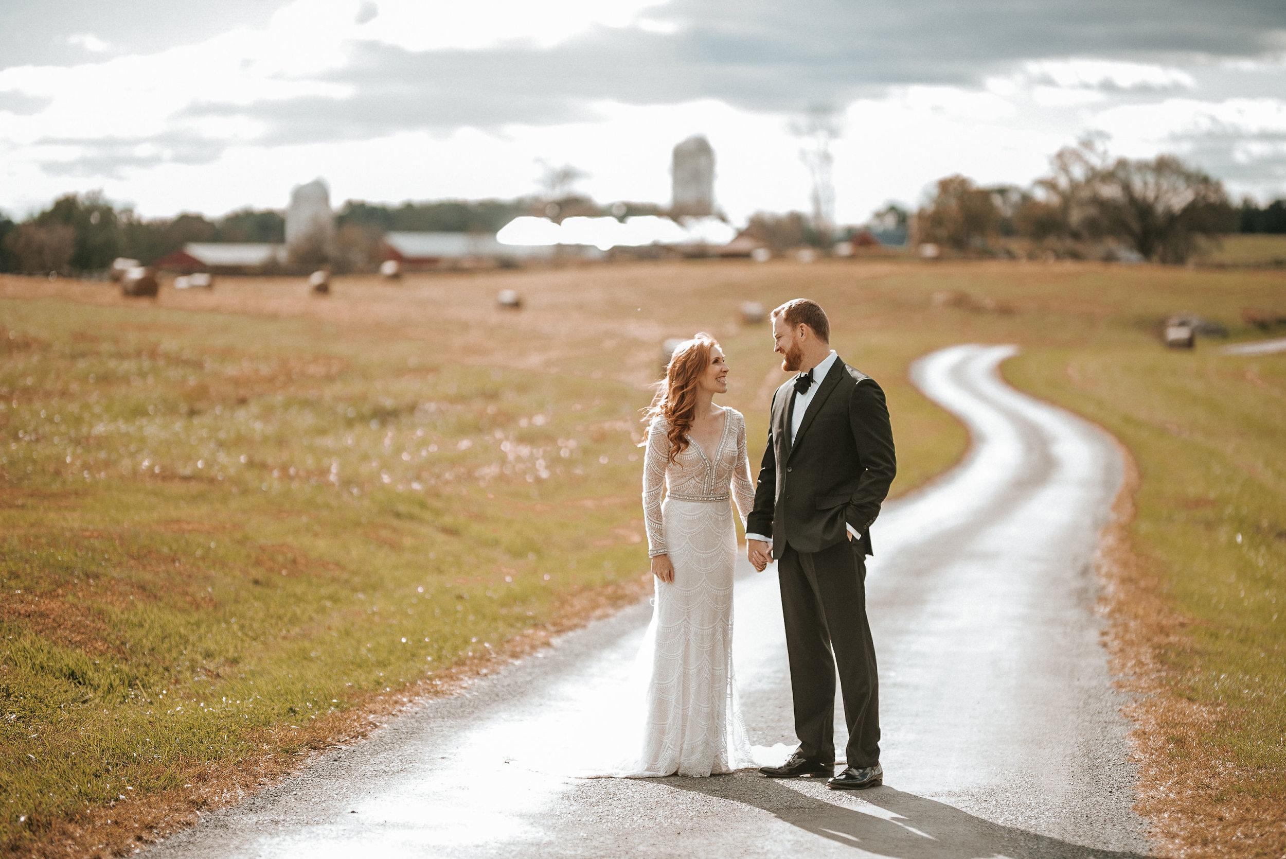 bride and groom holding hands at Goodstone Inn & Restaurant