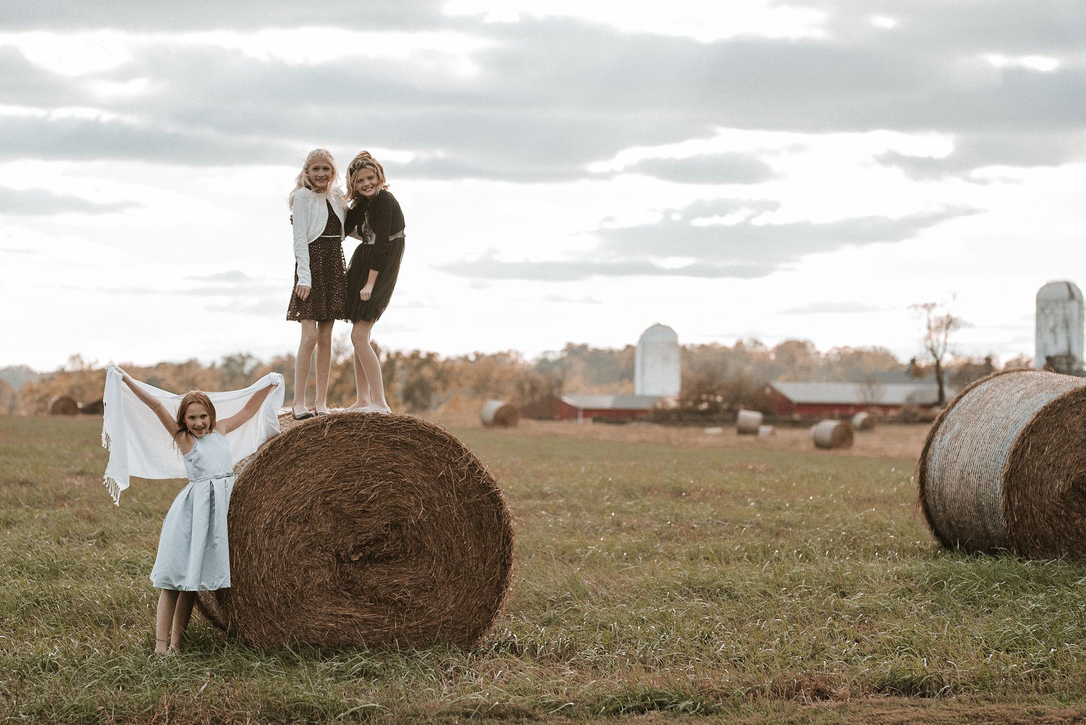 children playing on hay bales at Goodstone Inn & Restaurant