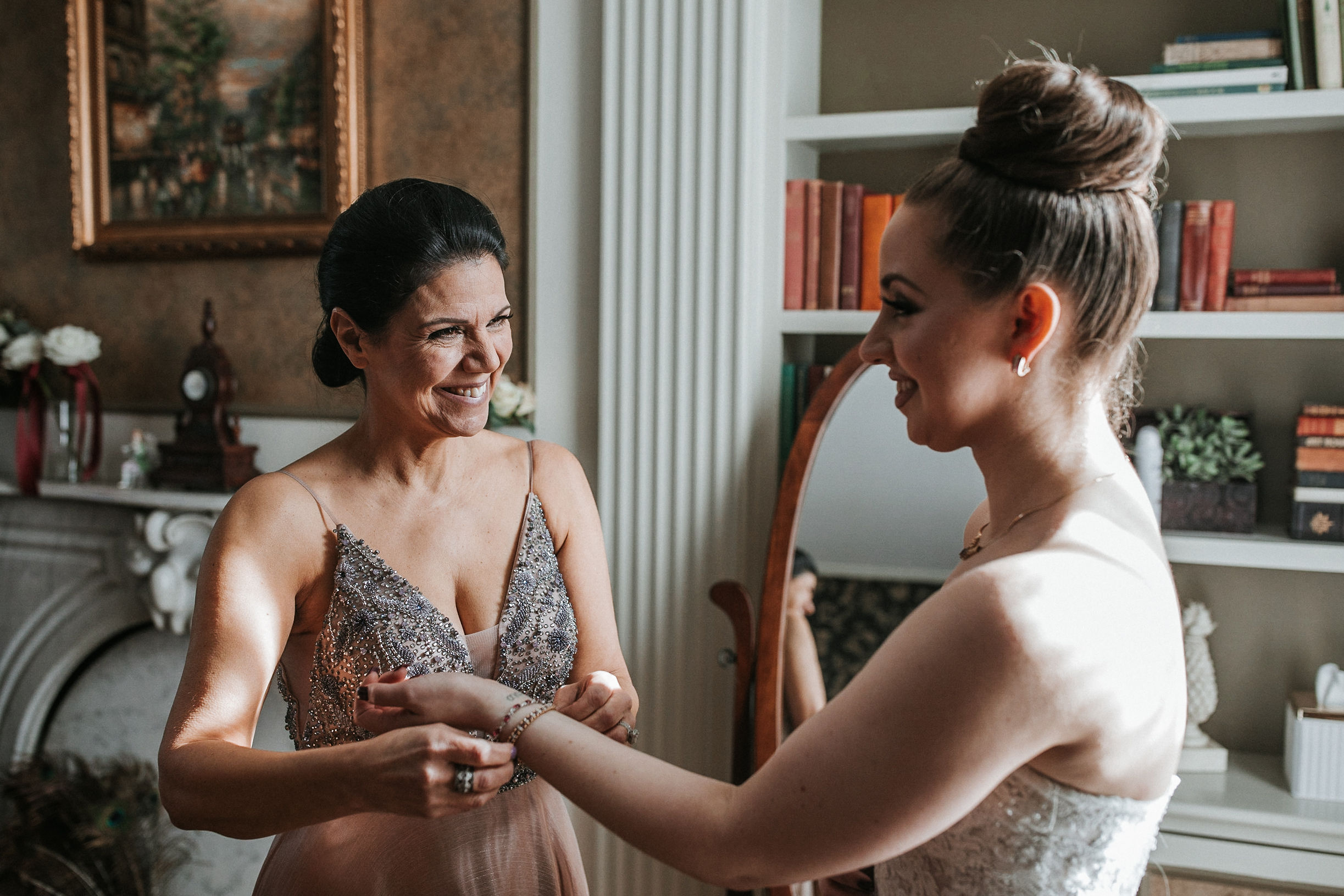 mother of the bride helping bride get ready at Whitehall Estate