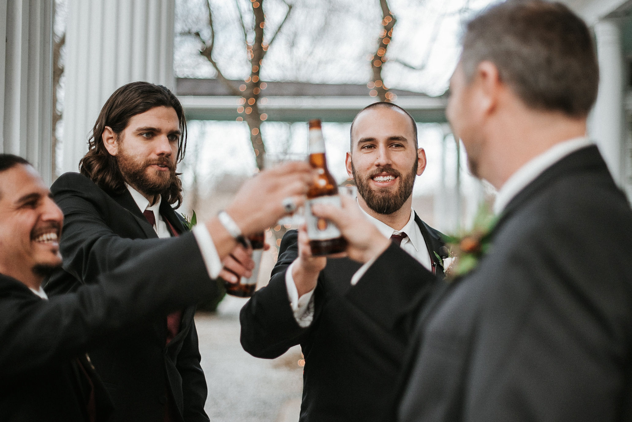 groom drinking with groomsmen at Whitehall Estate
