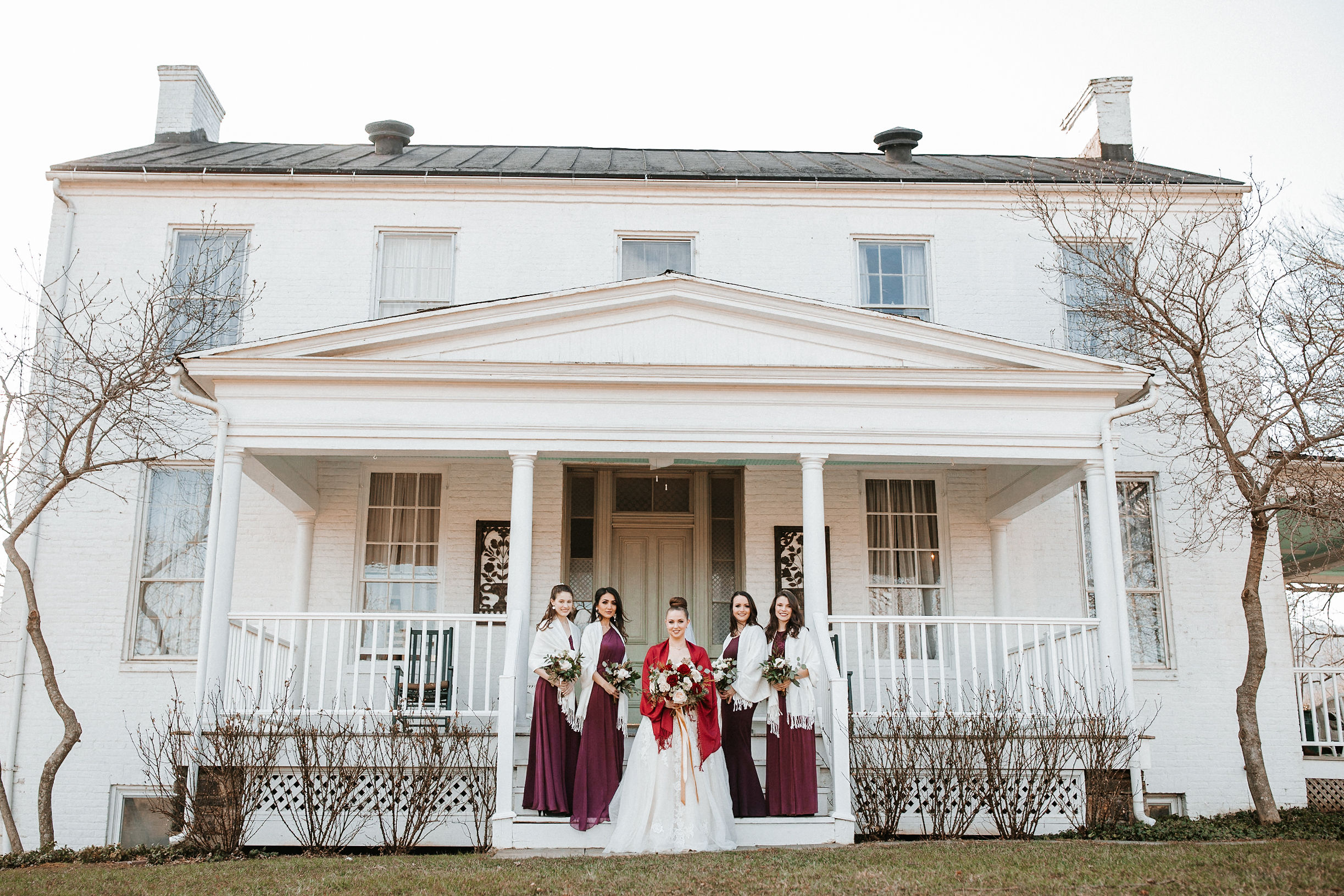 bride and bridesmaids posing at Whitehall Estate