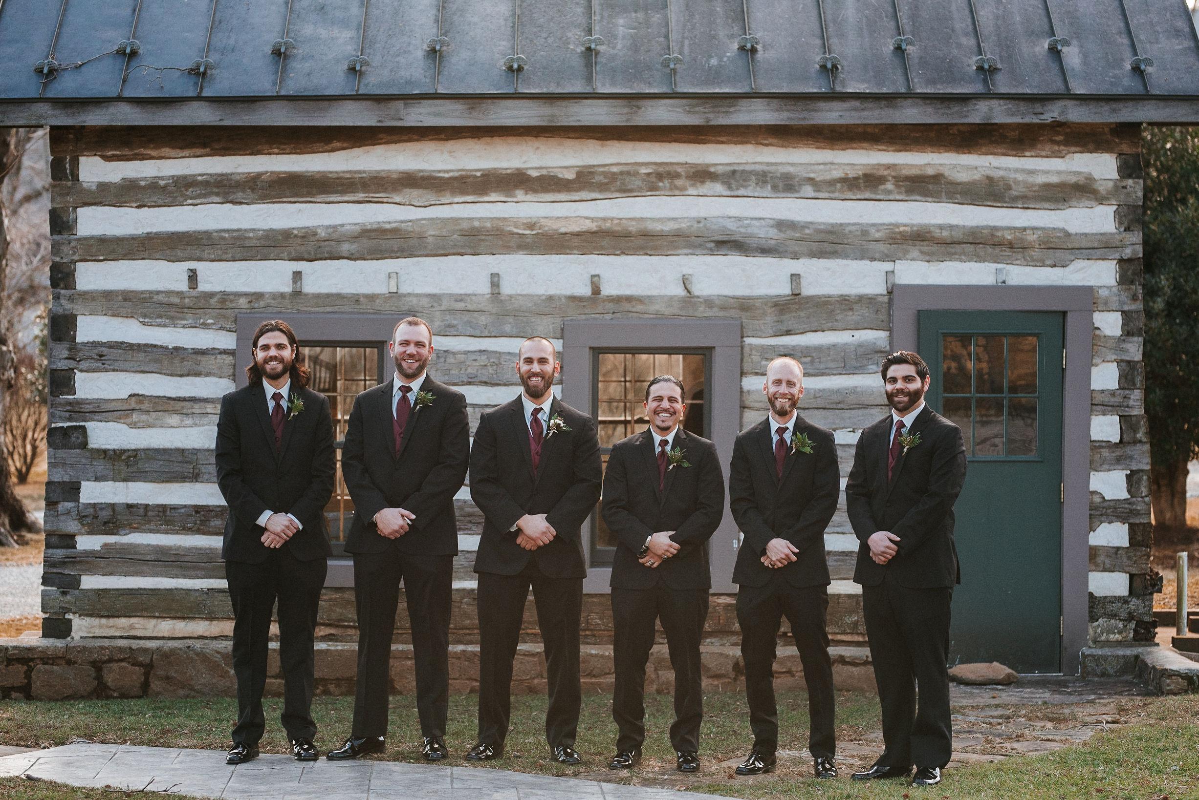 groom and groomsmen smiling at Whitehall Estate
